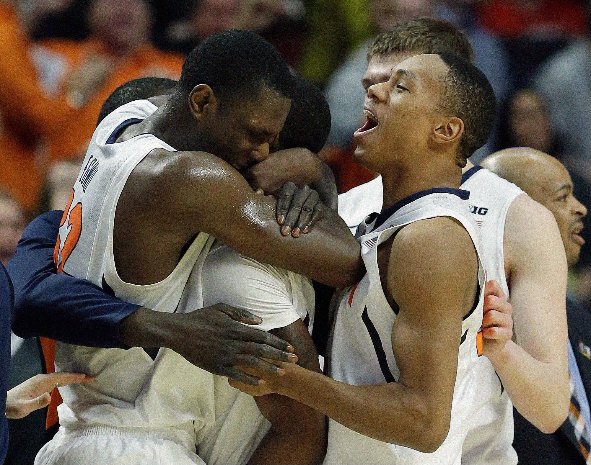 Illinois' Brandon Paul is swarmed by teammates after making the game-winning shot Thursday against Minnesota at the Big Ten tournament in Chicago.