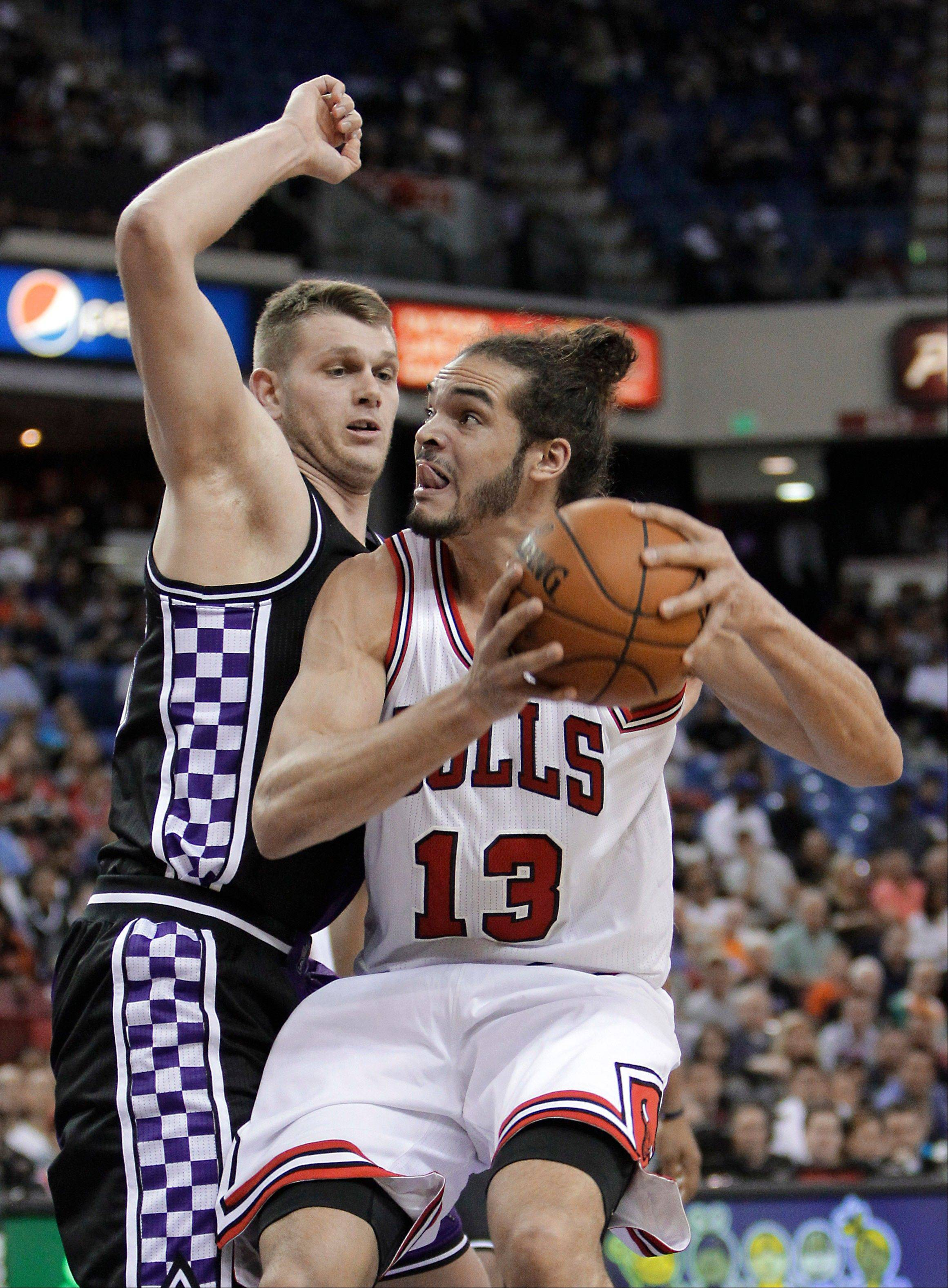 Chicago Bulls center Joakim Noah, right, looks to go to the basket against Kings center Cole Aldrich Wednesday night in Sacramento. The Bulls lost 121-79.