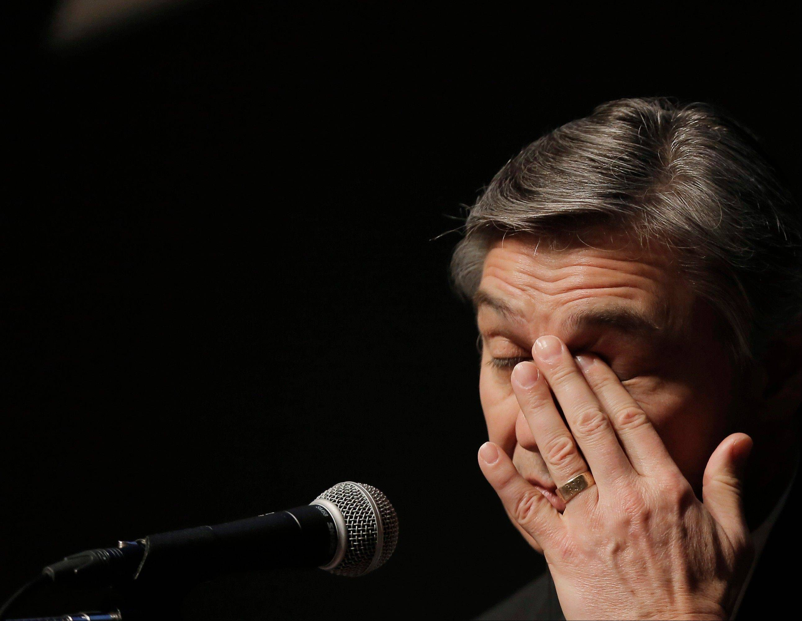 Boeing Commercial Airplanes President and CEO Ray Conner rubs his eye Friday during a news conference in Tokyo.