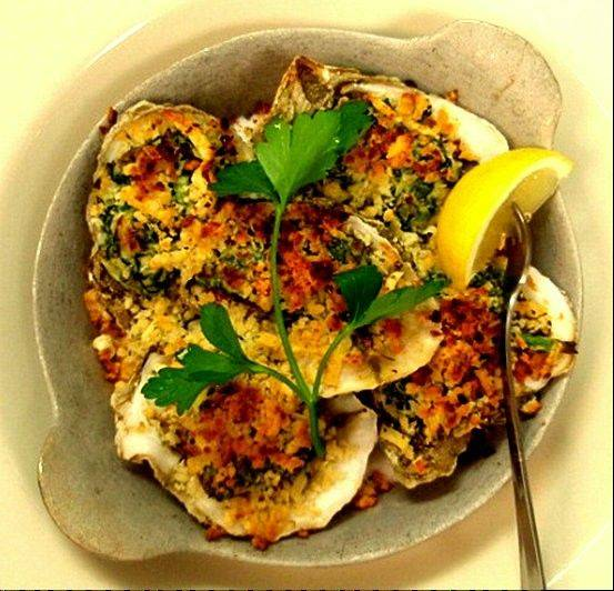Grilled oysters Rockefeller made Weber Grill's new founder's menu. It's made with a creamy spinach, applewood smoked bacon and Pernod.