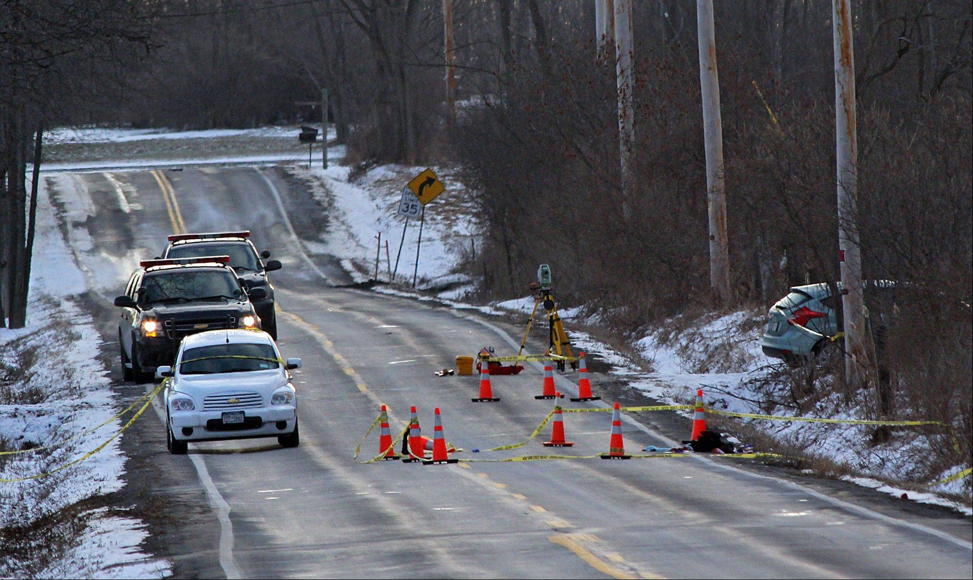 New York State Police investigate a car Friday involved in a fatal carjacking on Verplank Road, Clay, N.Y.