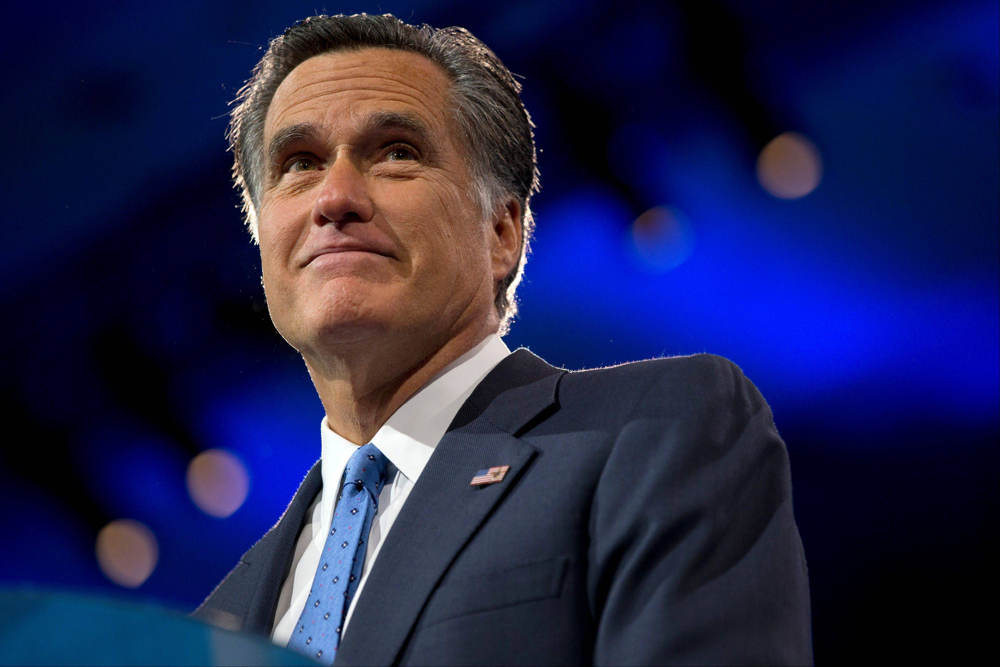 Former Massachusetts governor and 2012 Republican presidential candidate, Mitt Romney pauses while speaking Friday at the 40th annual Conservative Political Action Conference in National Harbor, Md.