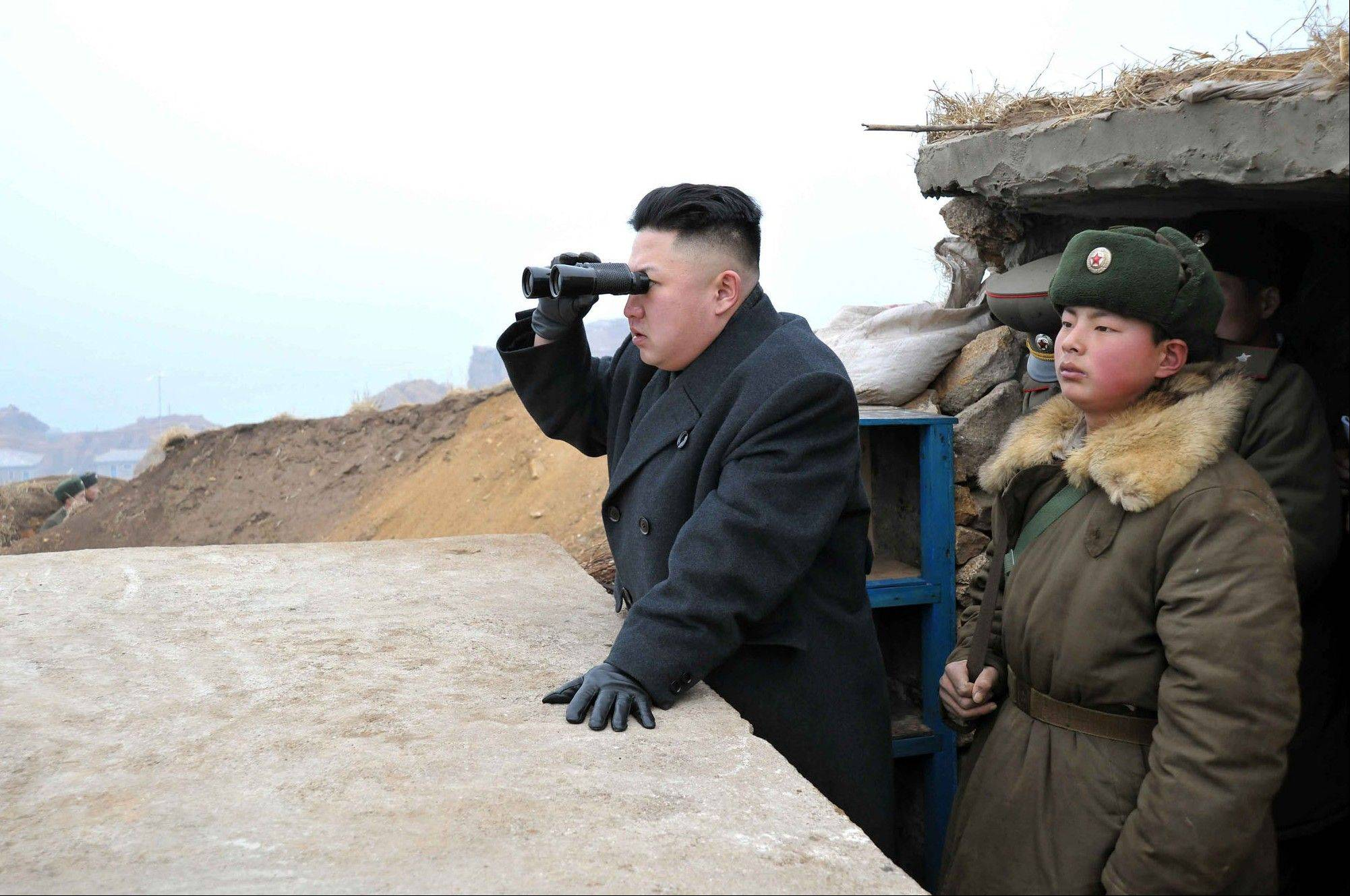 Associated Press/March 7, 2013 North Korean leader Kim Jong Un, center, uses binoculars to look at the South�s territory from an observation post at the military unit on Jangjae islet, located in the southernmost part of North Korea�s border with South Korea.