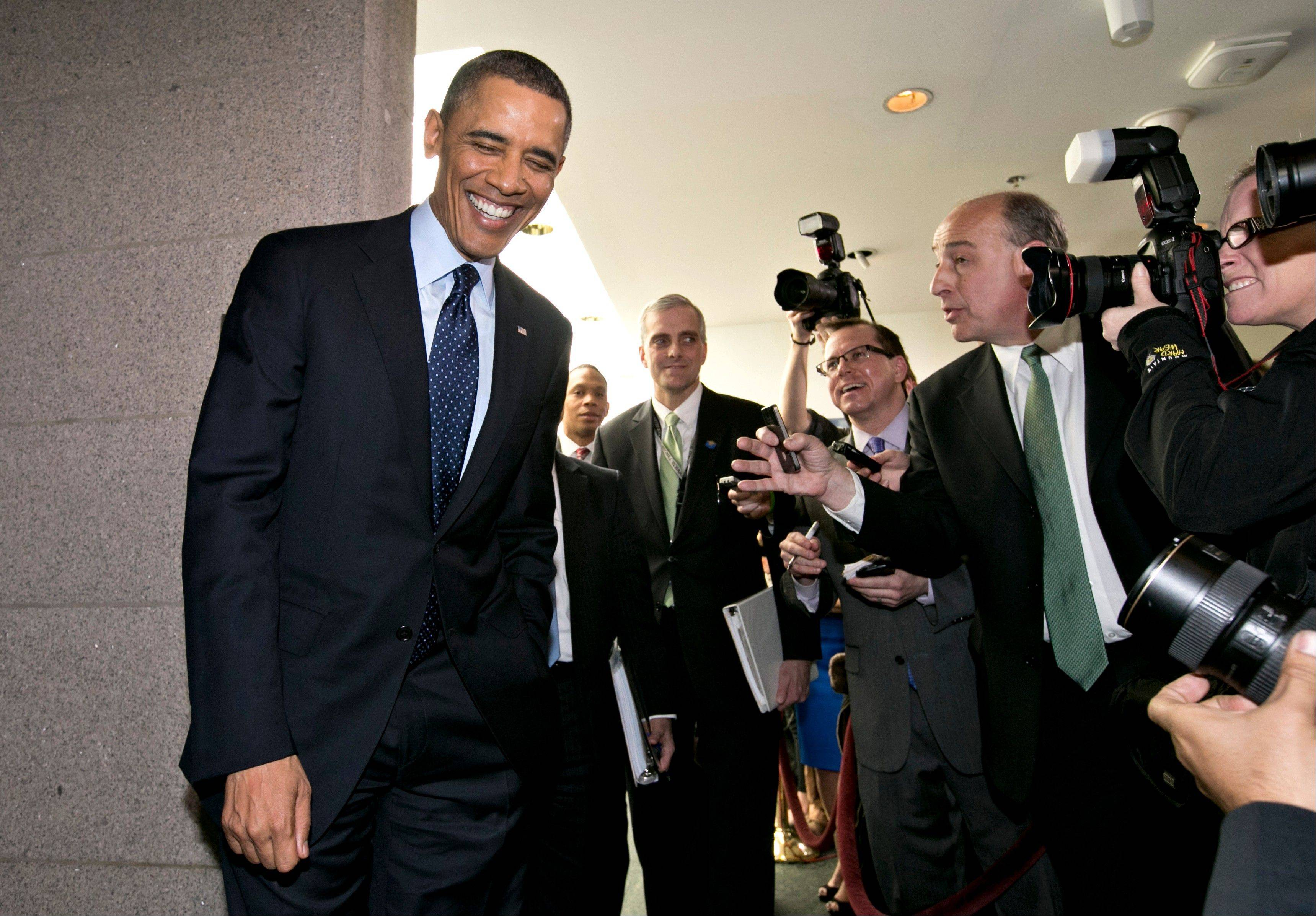 President Barack Obama turns to reporters Wednesday as he leaves the Capitol. Obama is pushing Congress to authorize more federally funded research into clean energy technologies that can wean automobiles off oil.