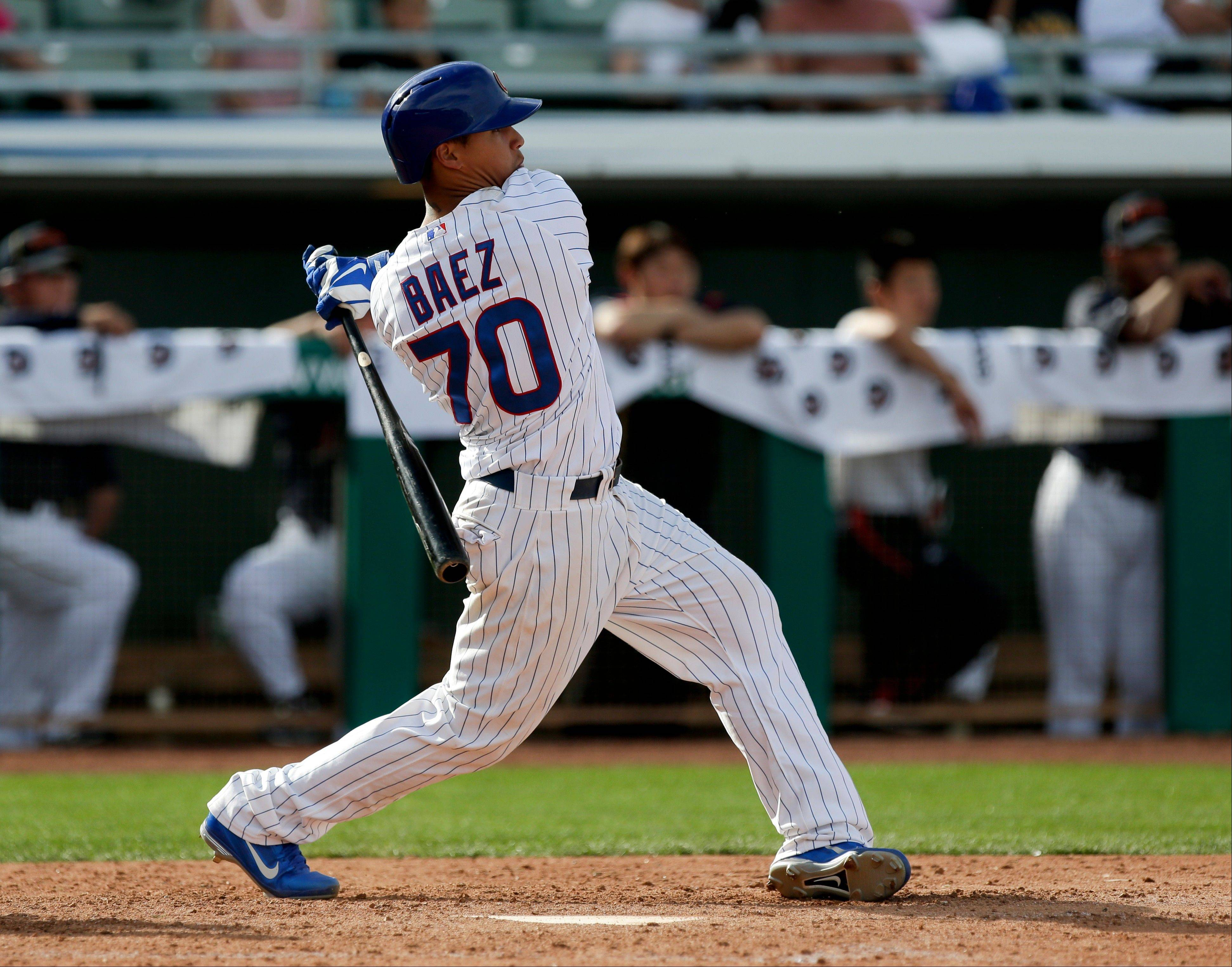 Chicago Cubs' Javier Baez watches his walk off two-run home run against Japan during the bottom the ninth inning of an exhibition spring training baseball game in Mesa, Ariz. Friday, March 15, 2013. (AP Photo/Chris Carlson)