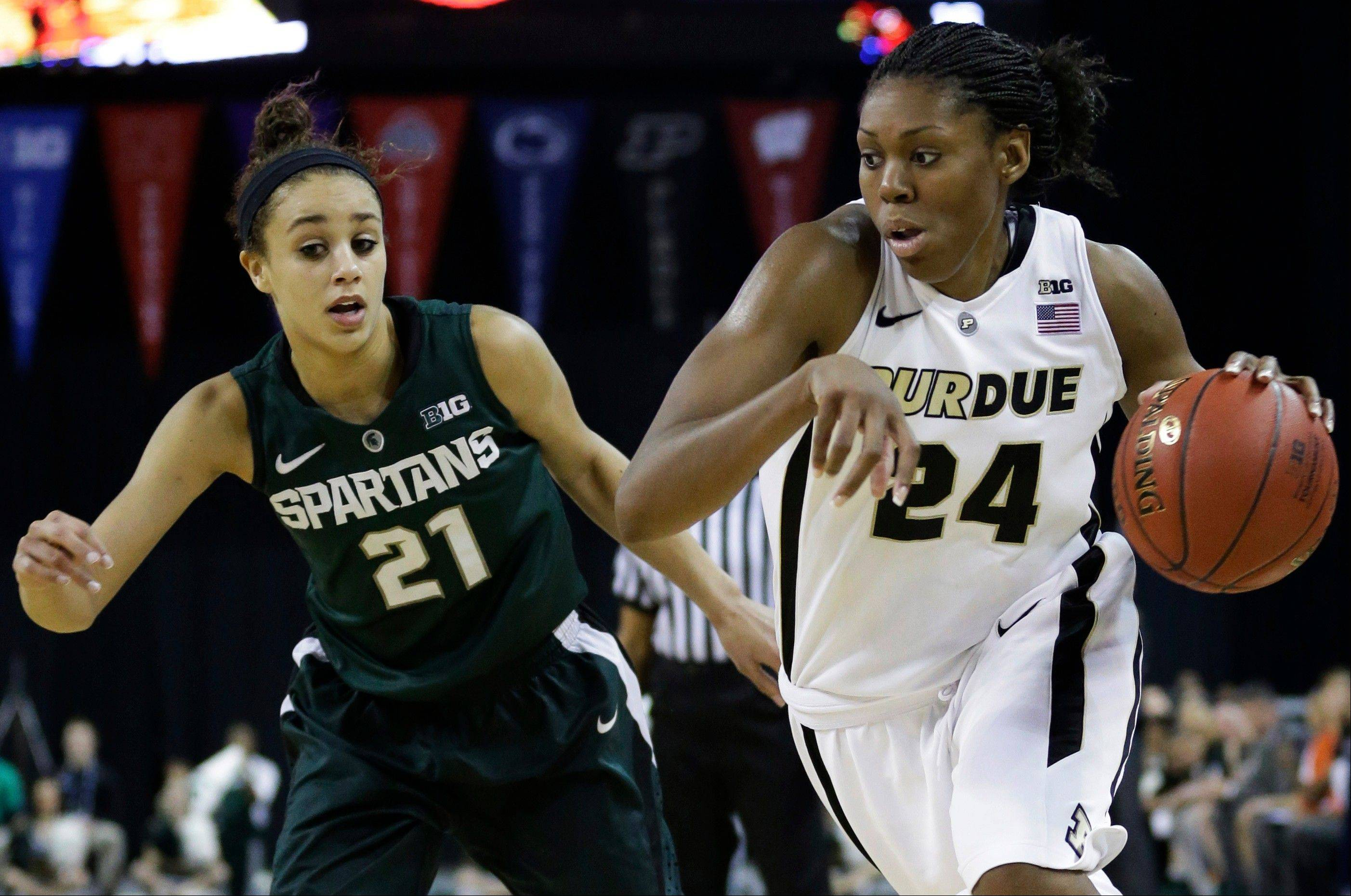 Purdue forward Drey Mingo, right, earned Most Outstanding Player honors at last week's Big Ten women's basketball tournament. Mingo, who wears hearing aids, also directs a foundation that assists children with hearing loss.