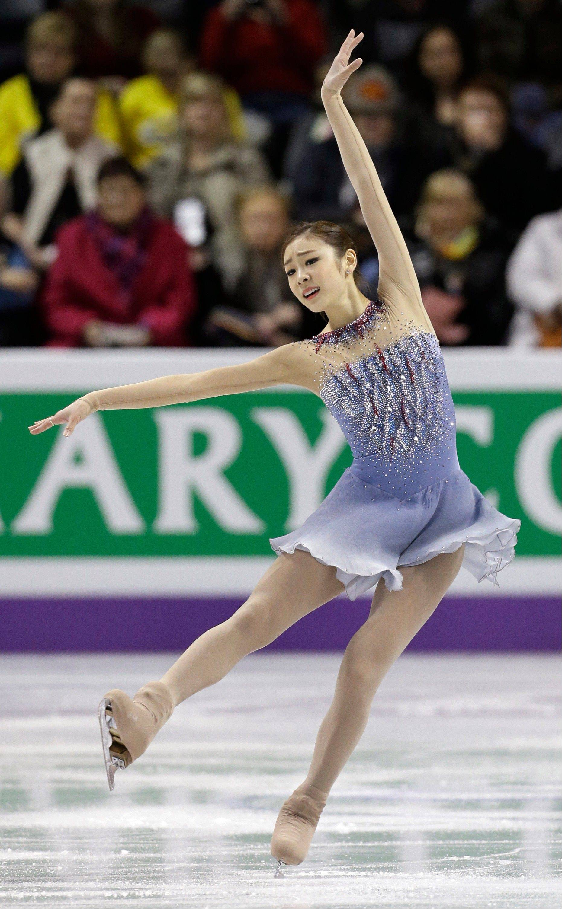 Kim Yu-na of South Korea performs during the ladies short program at the World Figure Skating Championships Thursday, March 14, 2013, in London, Ontario. (AP Photo/Darron Cummings)