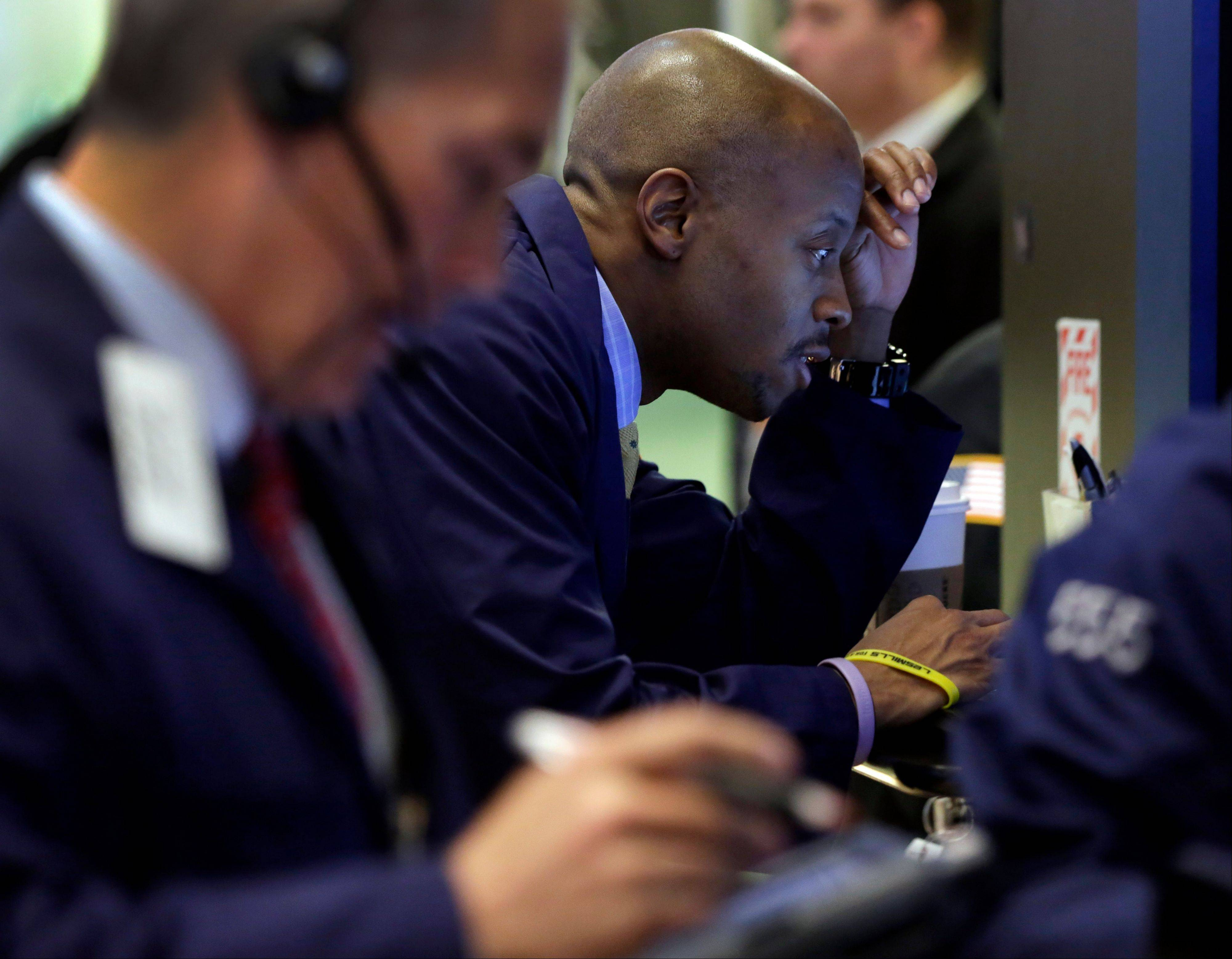 Traders work on the floor of the New York Stock Exchange Friday.