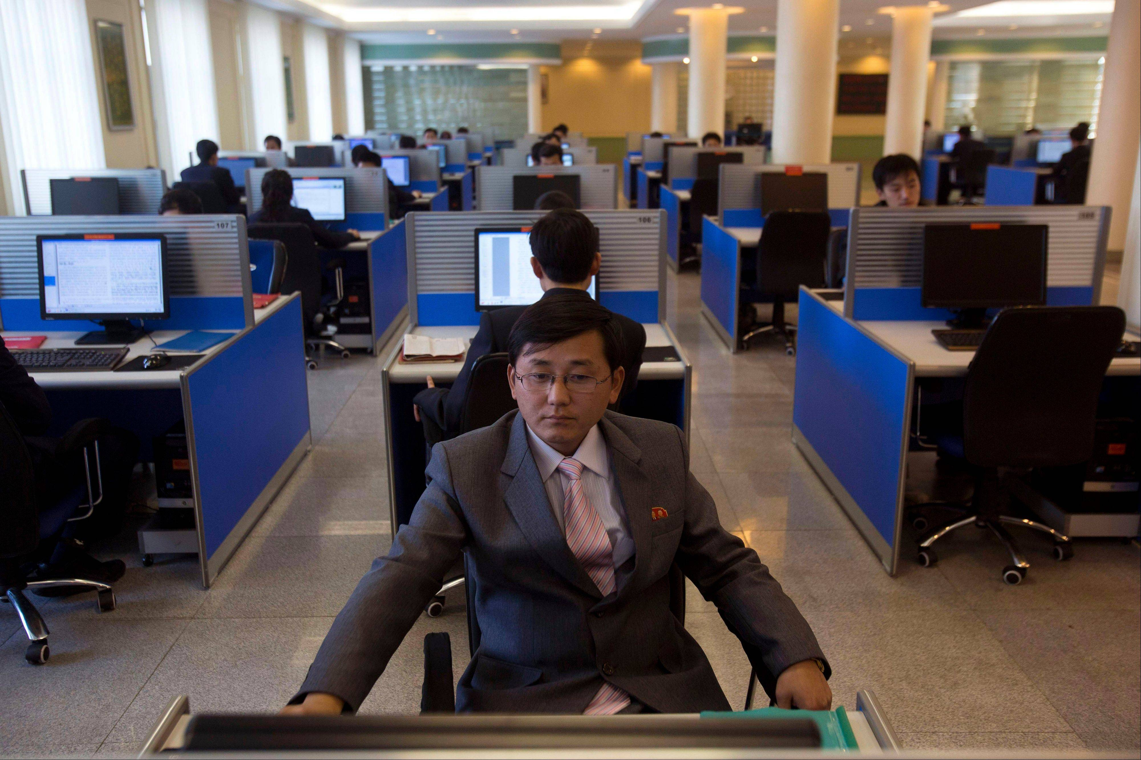 A North Korean student surfs the Internet at a computer terminal inside a computer lab at Kim Il Sung University in Pyongyang, North Korea during a tour by Executive Chairman of Google Eric Schmidt. North Korea on Friday blamed South Korea and the United States for cyberattacks that temporarily shut down websites this week at a time of elevated tensions over the North's nuclear ambitions. Experts, however, indicated it could take months to determine what happened and one analyst suggested more likely culprits: hackers in China.