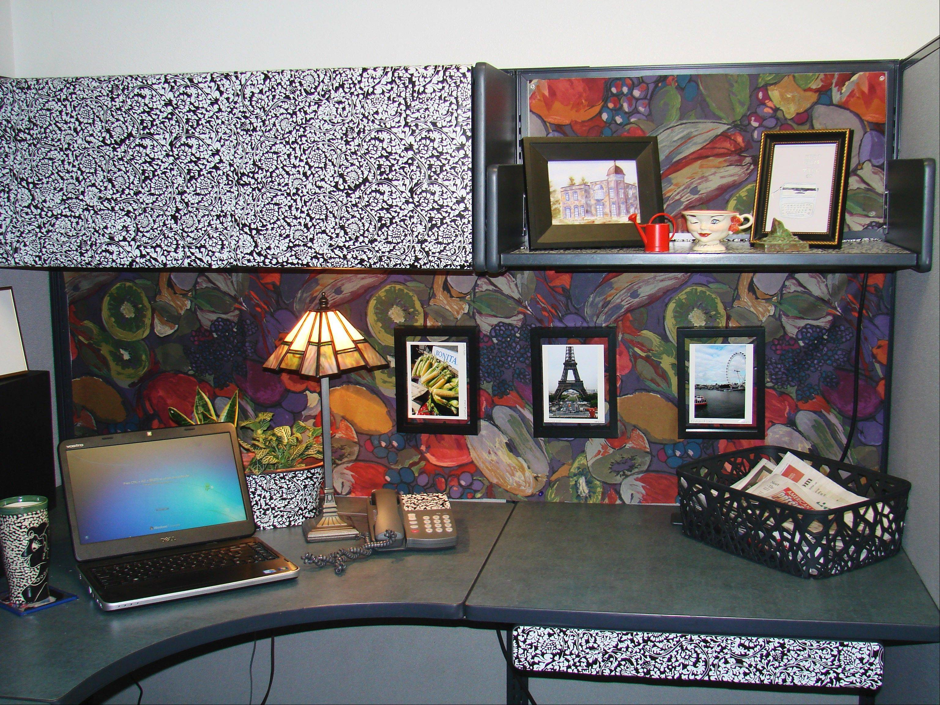 Following the expert advice of several interior designers, this cubicle at a Thornton, Colo., business was styled using a bold fabric on the cubicle wall and black-and-white contact paper on an upper cabinet and various accessories.