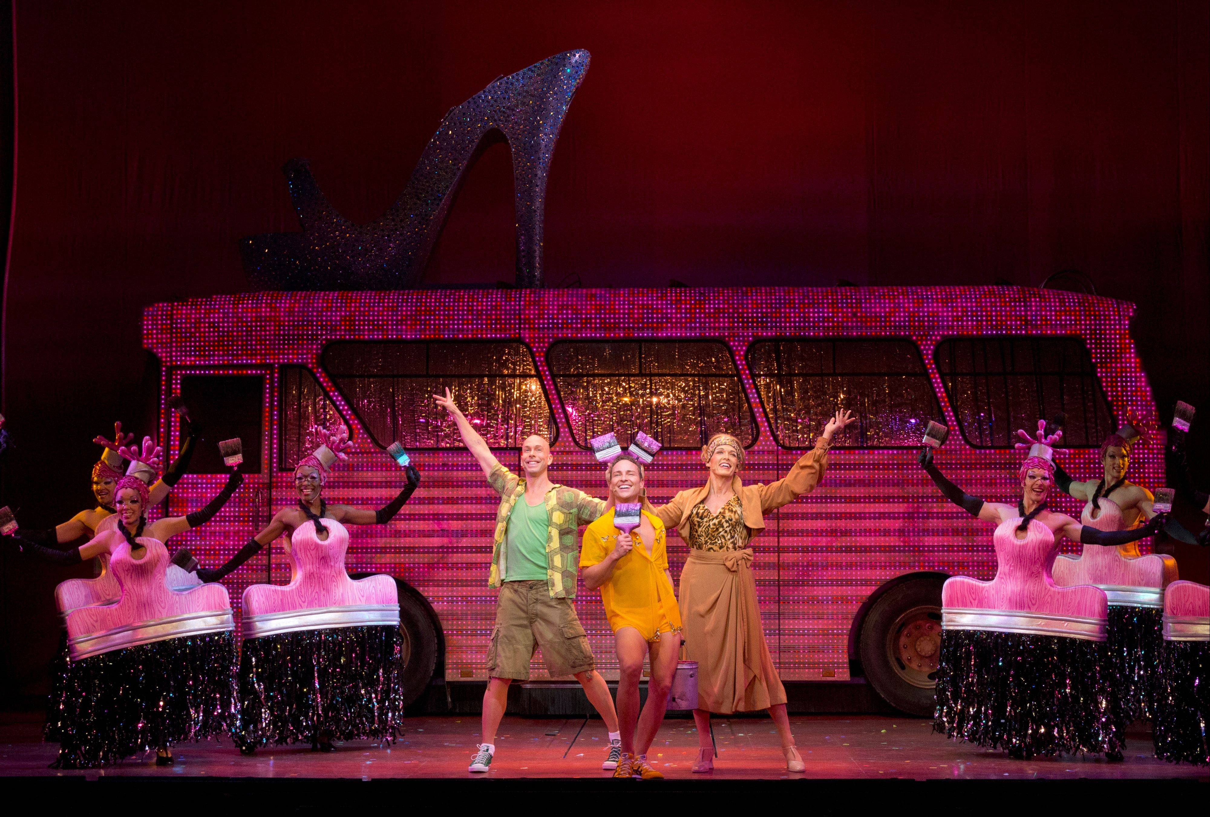 "Wade McCollum, Bryan West and Scott Willis, center, lead the company of ""Priscilla Queen of the Desert The Musical"" in the production number ""Colour My World."" Algonquin and Glencoe native Christy Faber says the chorus paintbrush costume she wears in this number is perhaps the most outlandish one she dons in the show."