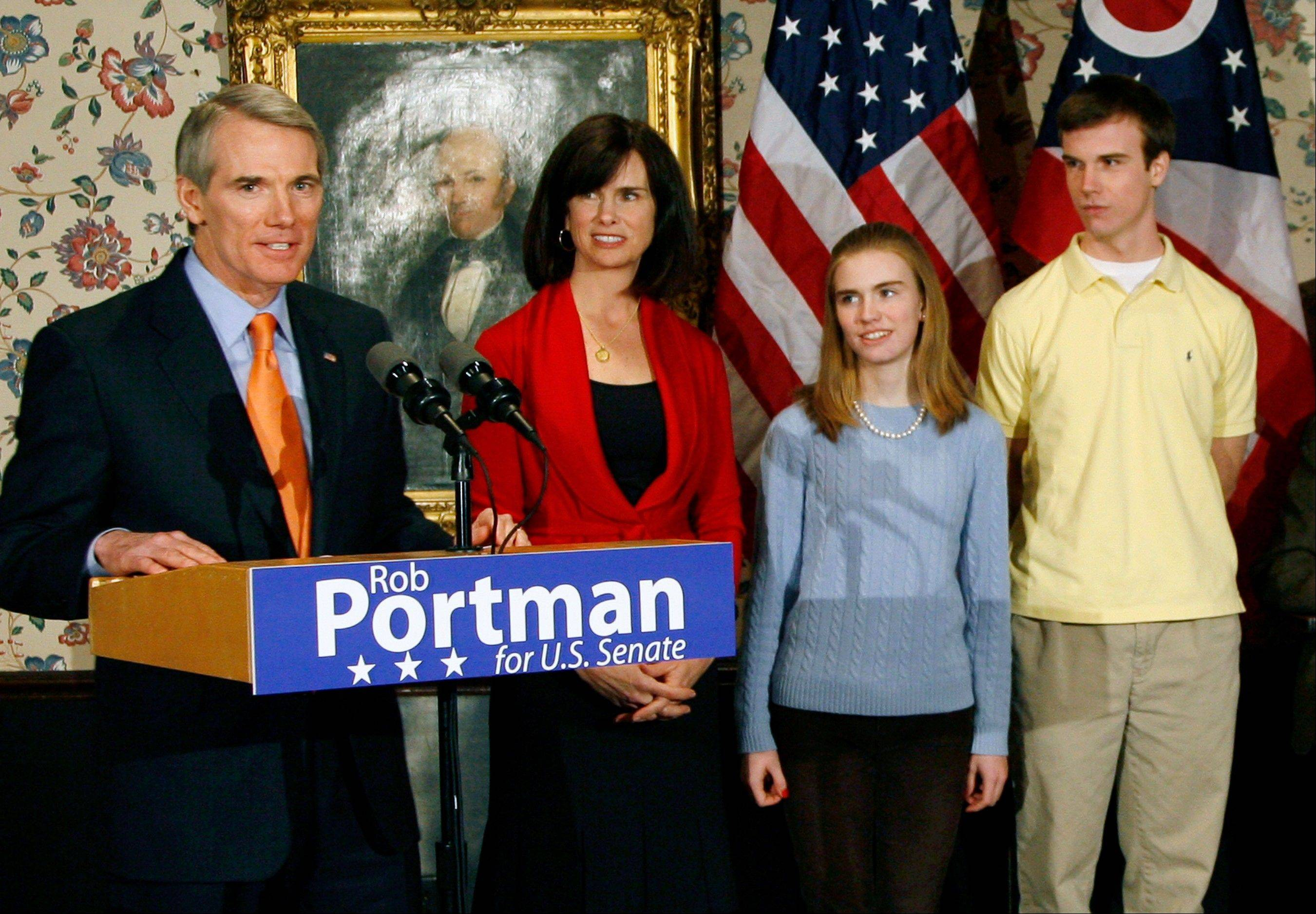 U.S. Sen. Rob Portman, from left, with his wife, Jane, daughter Sally, and son Will, stands after announcing that he will run for the U.S. Senate, in Lebanon, Ohio. Portman is now supporting gay marriage and says his reversal on the issue began when he learned his son Will is gay.