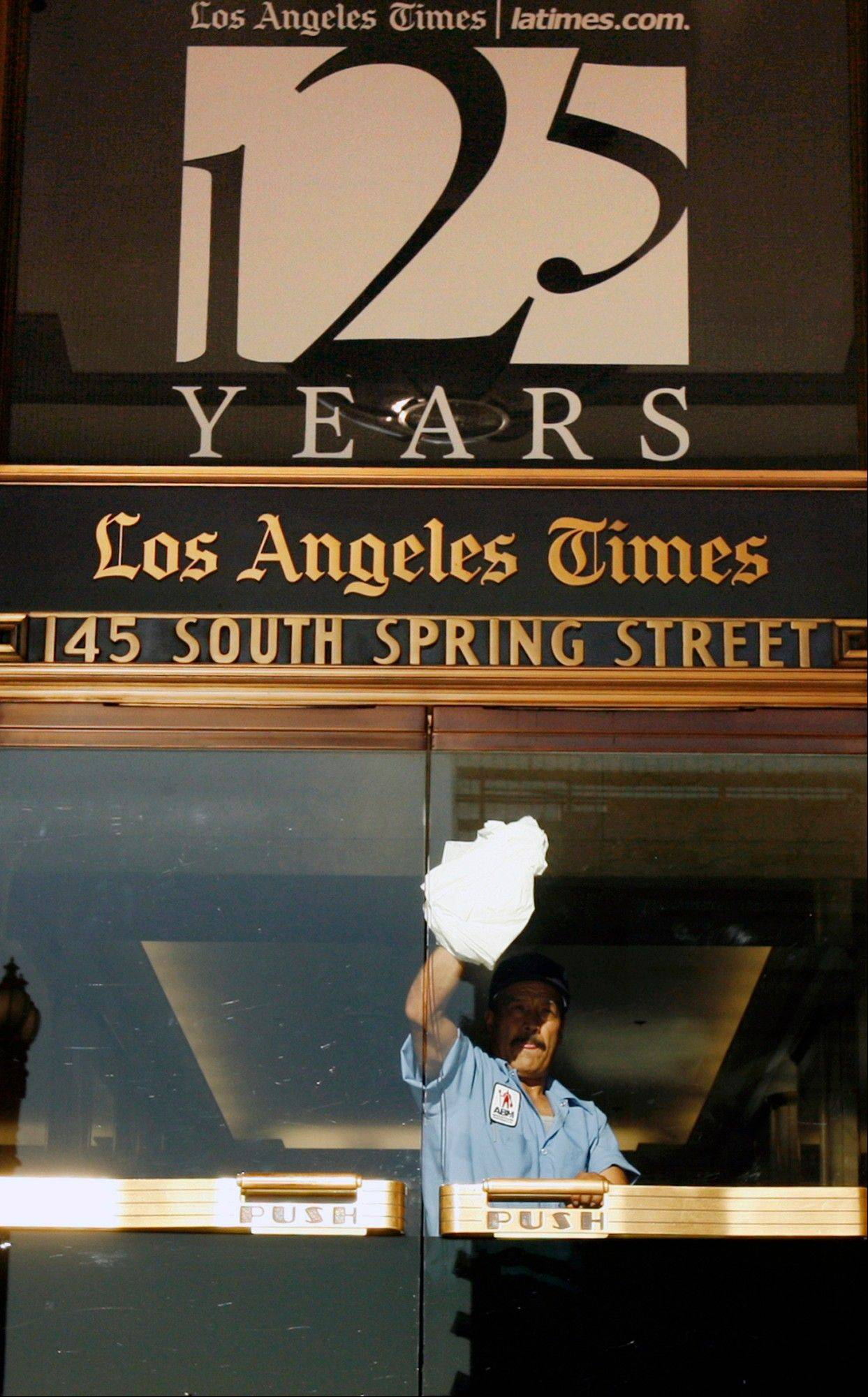 Associated Press/Nov. 16, 2006A worker cleans an entrance to the Los Angeles Times building in Los Angeles. Federal authorities allege that Matthew Keys provided hackers with login information to access the Tribune Company's computer system in December 2010.
