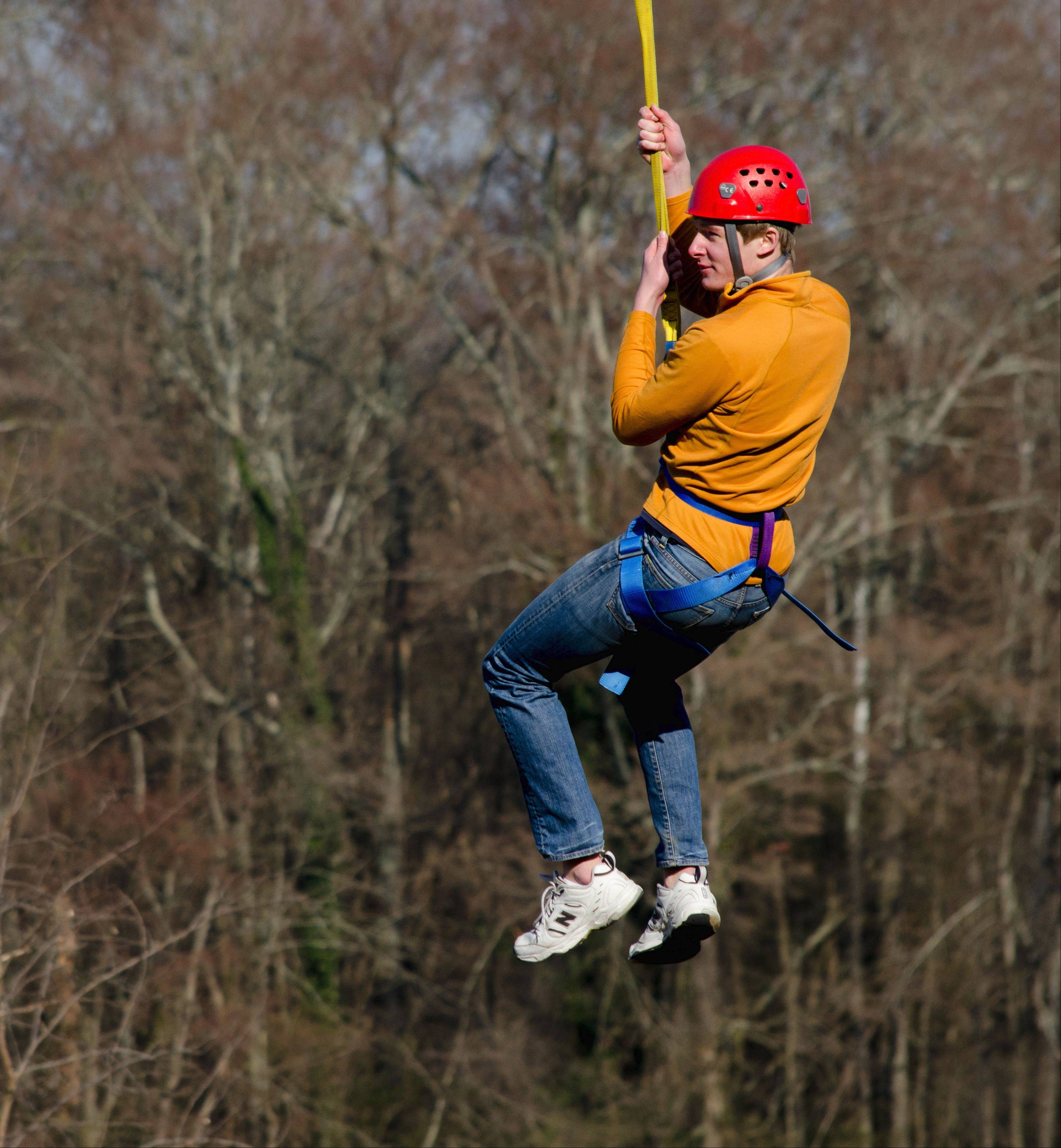 Charlie Sinkler of Des Plaines gets a turn on the zip line at the Honeywell Leadership Challenge.