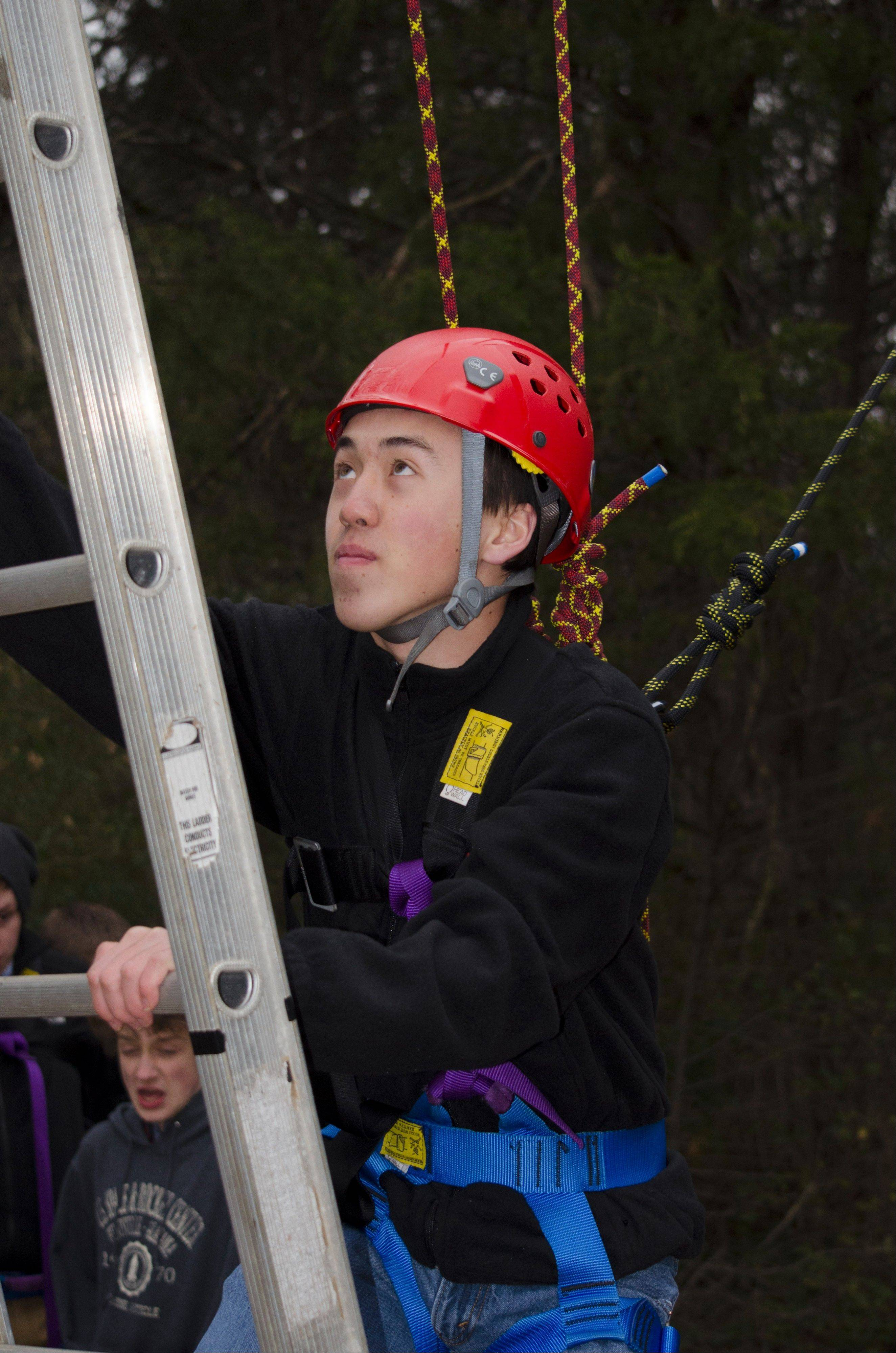 Patrick Grady of Mundelein climbs the 32-foot pamper pole at the Honeywell Leadership Challenge.