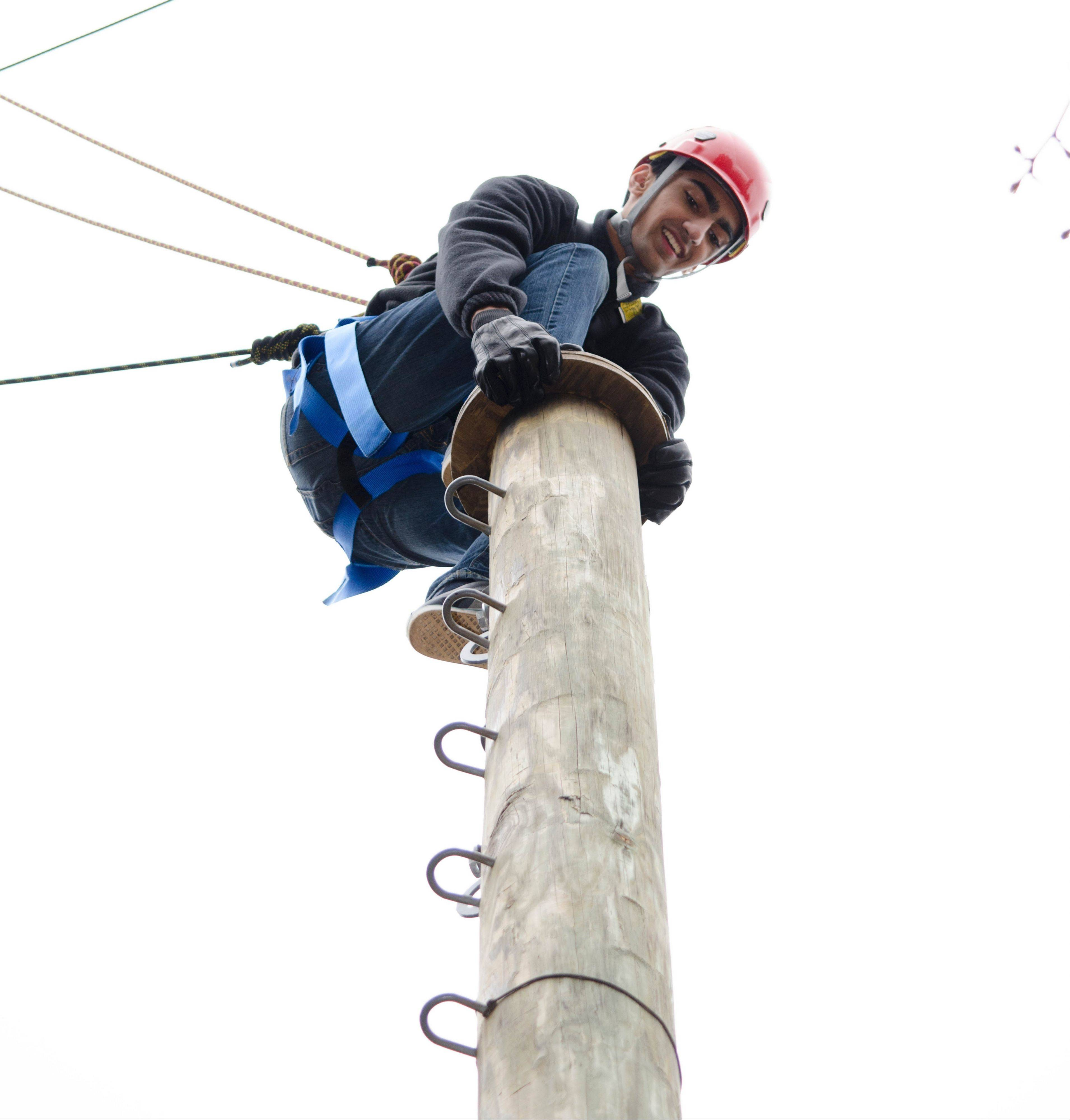 Rohan Shah of Aurora is in on top of the 32-foot pamper pole at the Honeywell Leadership Challenge.