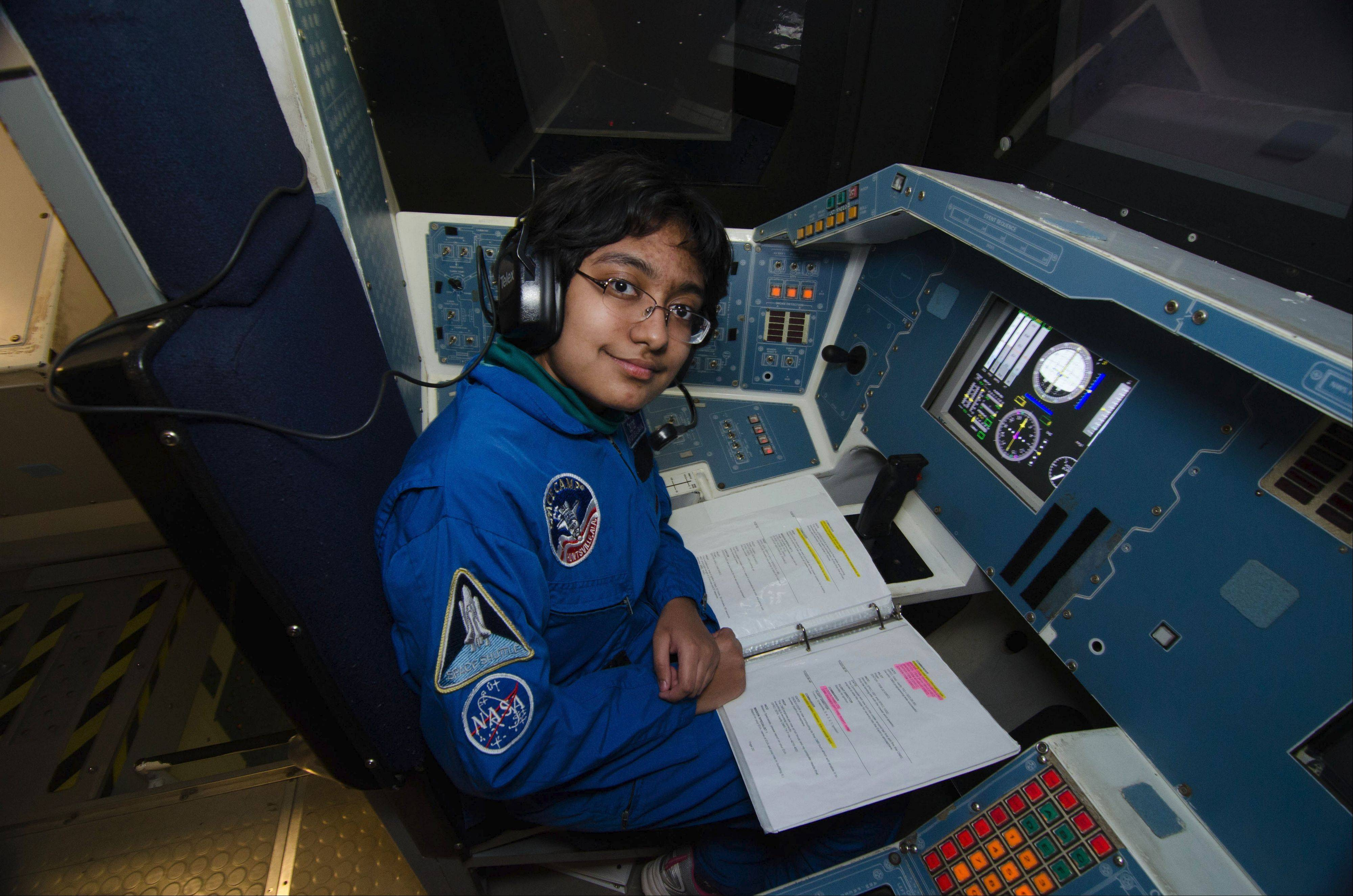 Parnita Harsh of Naperville pilots the shuttle simulator at the Honeywell Leadership Challenge.