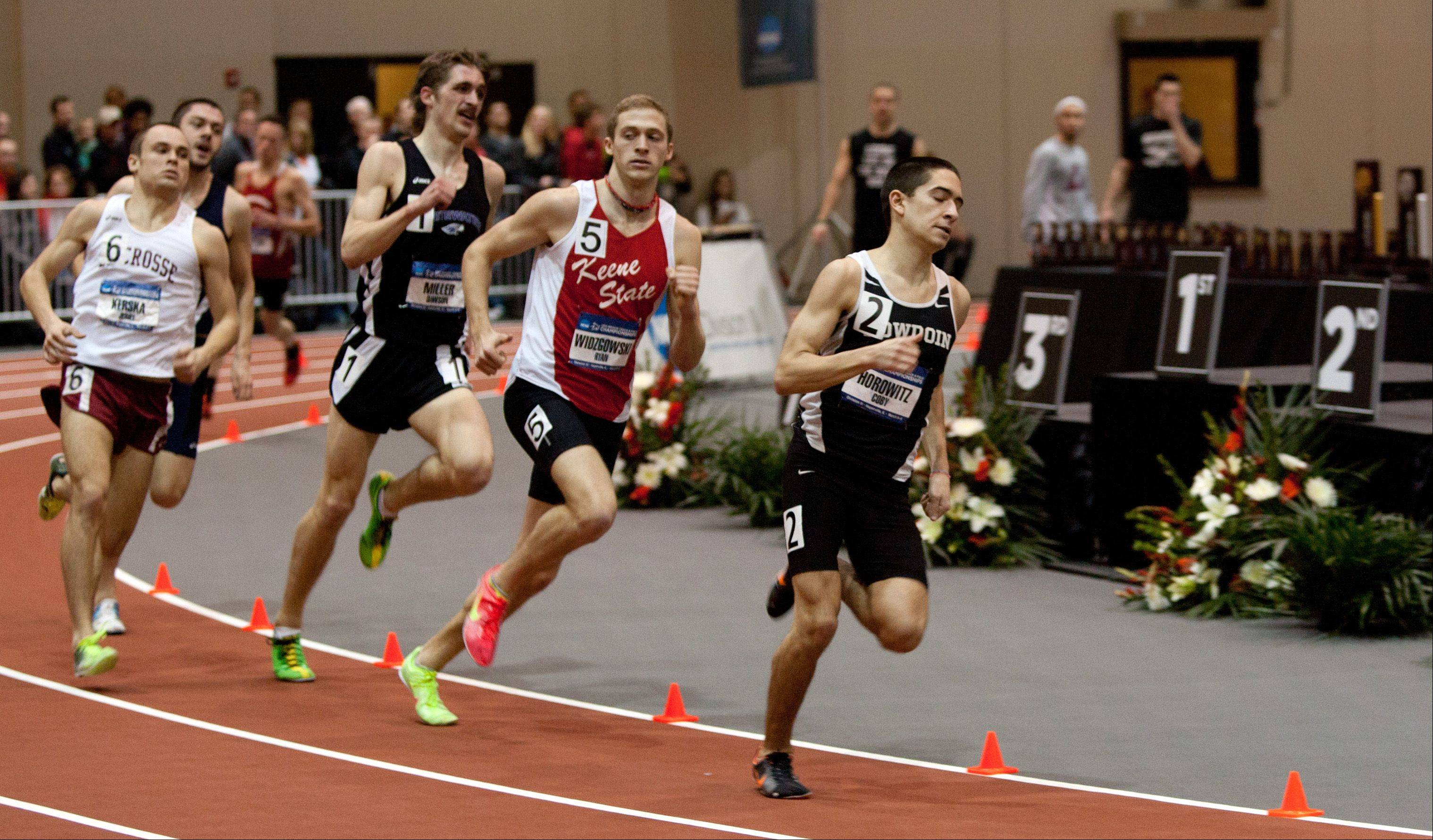 Runners head toward the finish in the preliminary heat of the mile run March 8 in Naperville during the NCAA Division III Indoor Track and Field Championships at North Central College.