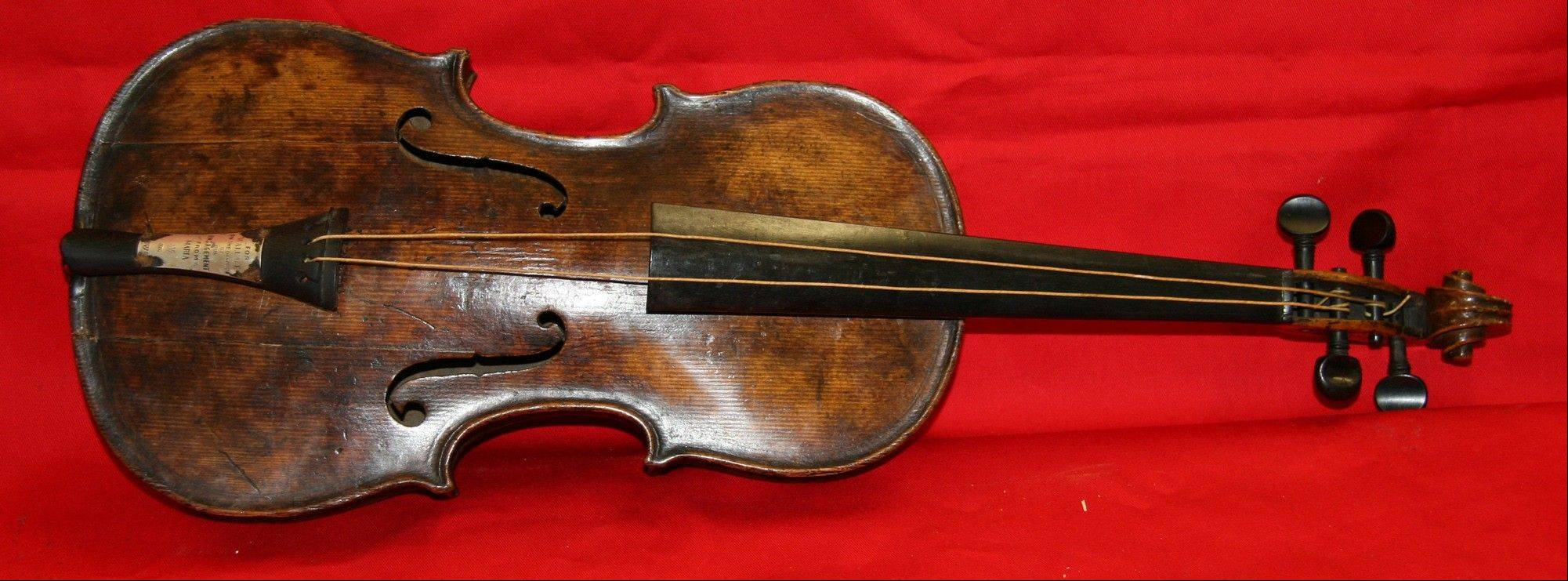 Auctioneers Henry Aldridge & Son say an instrument unearthed in 2006 has undergone rigorous testing and has proved to be the violin that was played by the bandmaster of the Titanic as the oceanliner sank. The auction house said has spent the past seven years and thousands of pounds determining the water-stained violin's origins, consulting numerous experts including government forensic scientists and Oxford University.