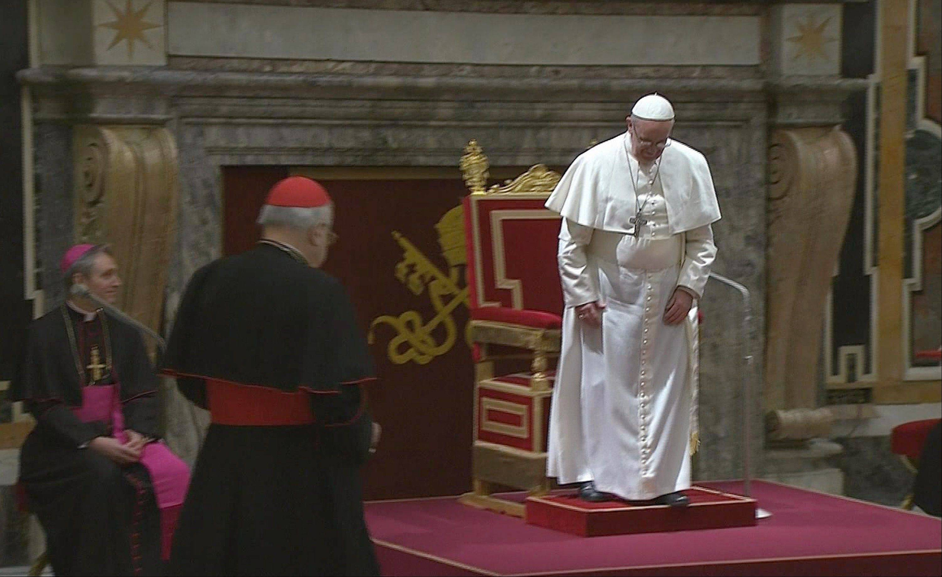 Pope Francis prepares to greet cardinals at the Vatican, Friday, March 15, 2013.