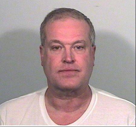 Paul Neff, 57, of the 19000 block of West Lake View Avenue near Mundelein, slashed his ex-girlfriend in the throat and face with a 6-inch butcher-style knife, Lake County Sheriff Mark Curran said, then killed himself as police surrounded him.