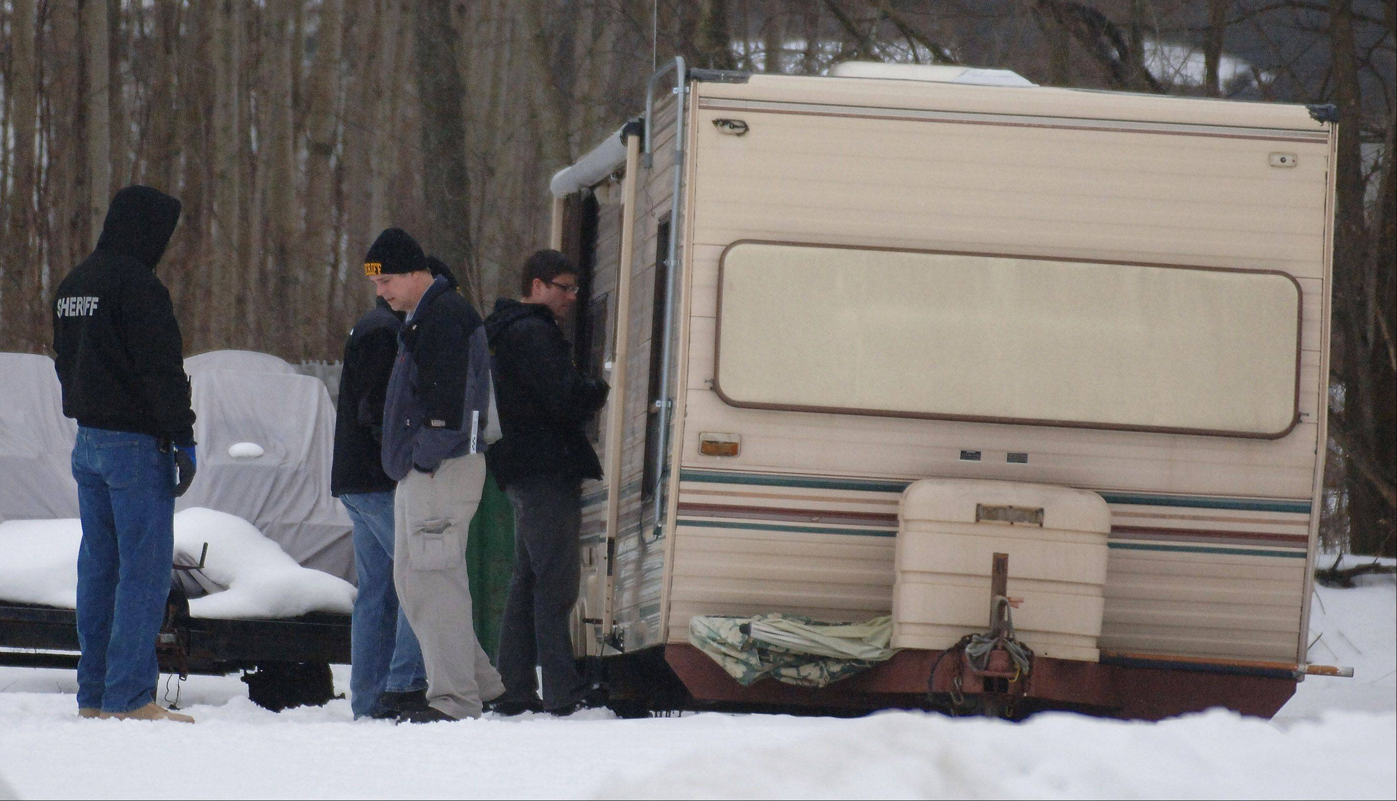 Police examine the camping trailer where murder suspect Paul Neff, 57, killed himself after a police standoff. Police say Neff, who lived in the Mundelein area, killed his ex-girlfriend, Diane Kephart.
