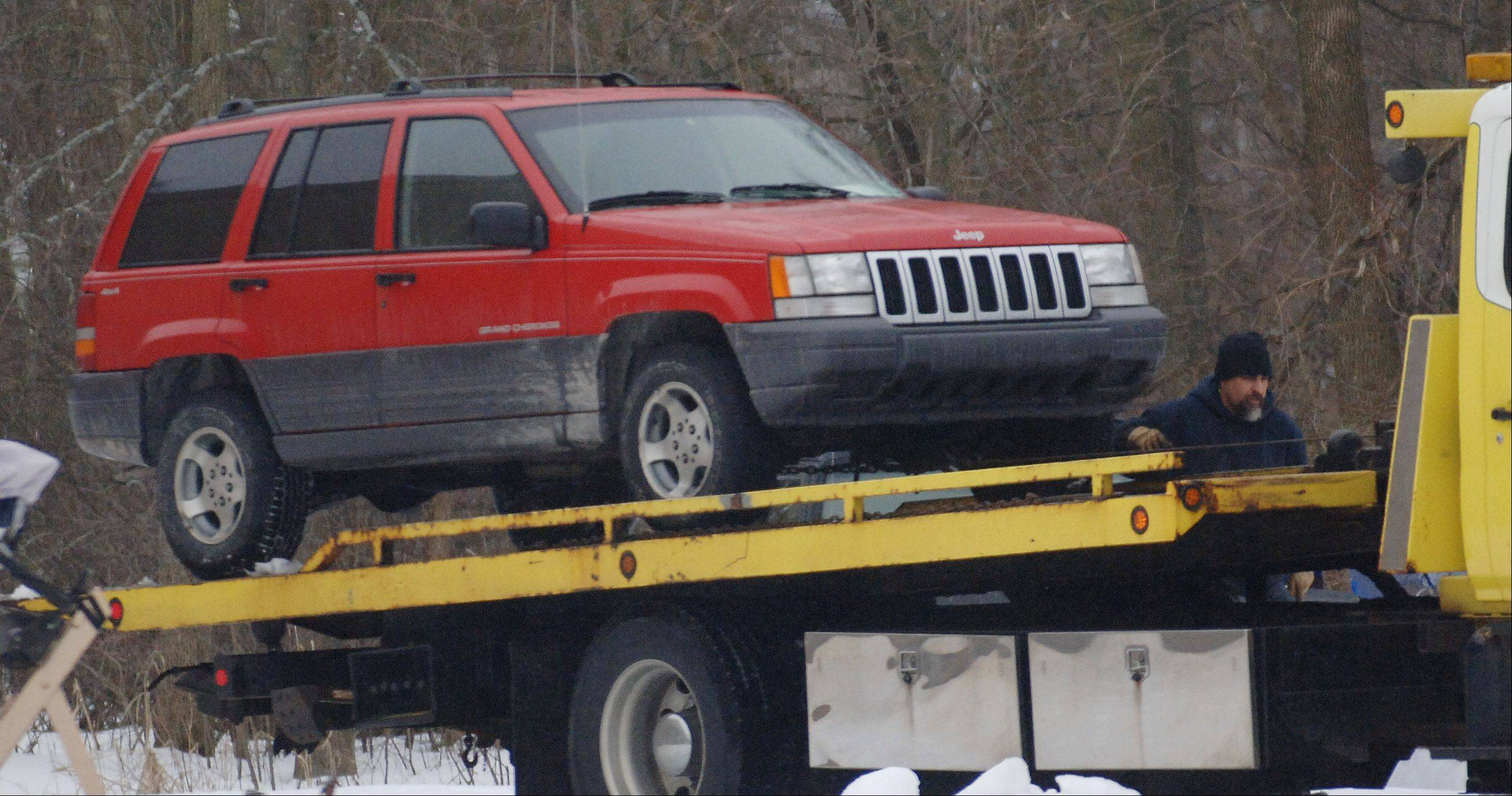 The vehicle owned by murder suspect Paul Neff is towed away. A suicide note was found inside.