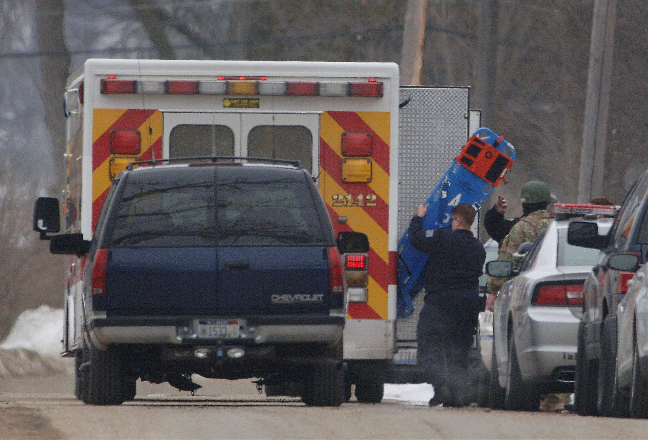 An ambulance arrives in an Antioch Township neighborhood after police found murder suspect Paul Neff had killed himself Friday morning. Police say Neff killed his ex-girlfriend Diane Kephart that morning.