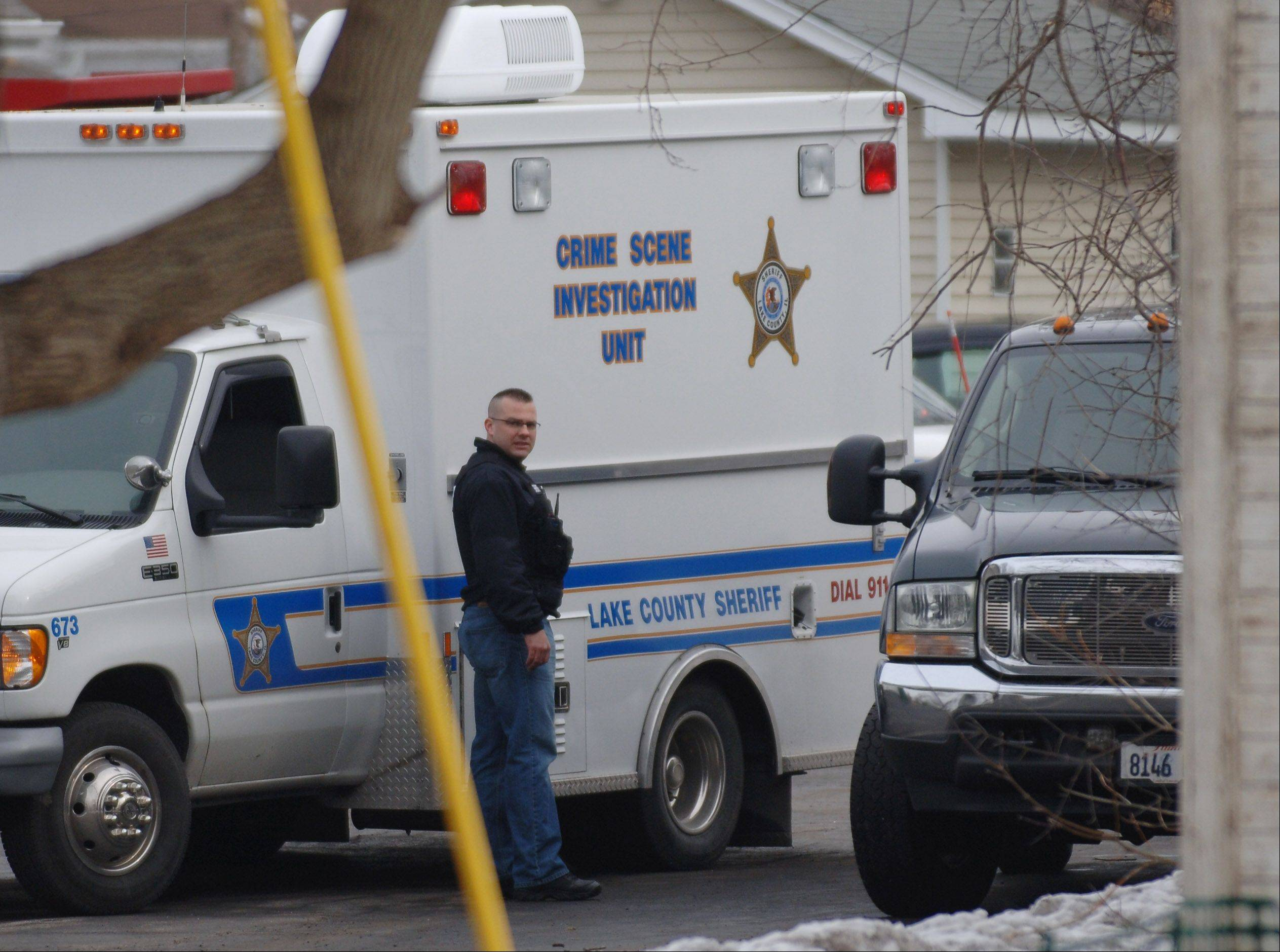 Police investigate a murder scene on N. Westlake Avenue in Antioch Township Friday morning.
