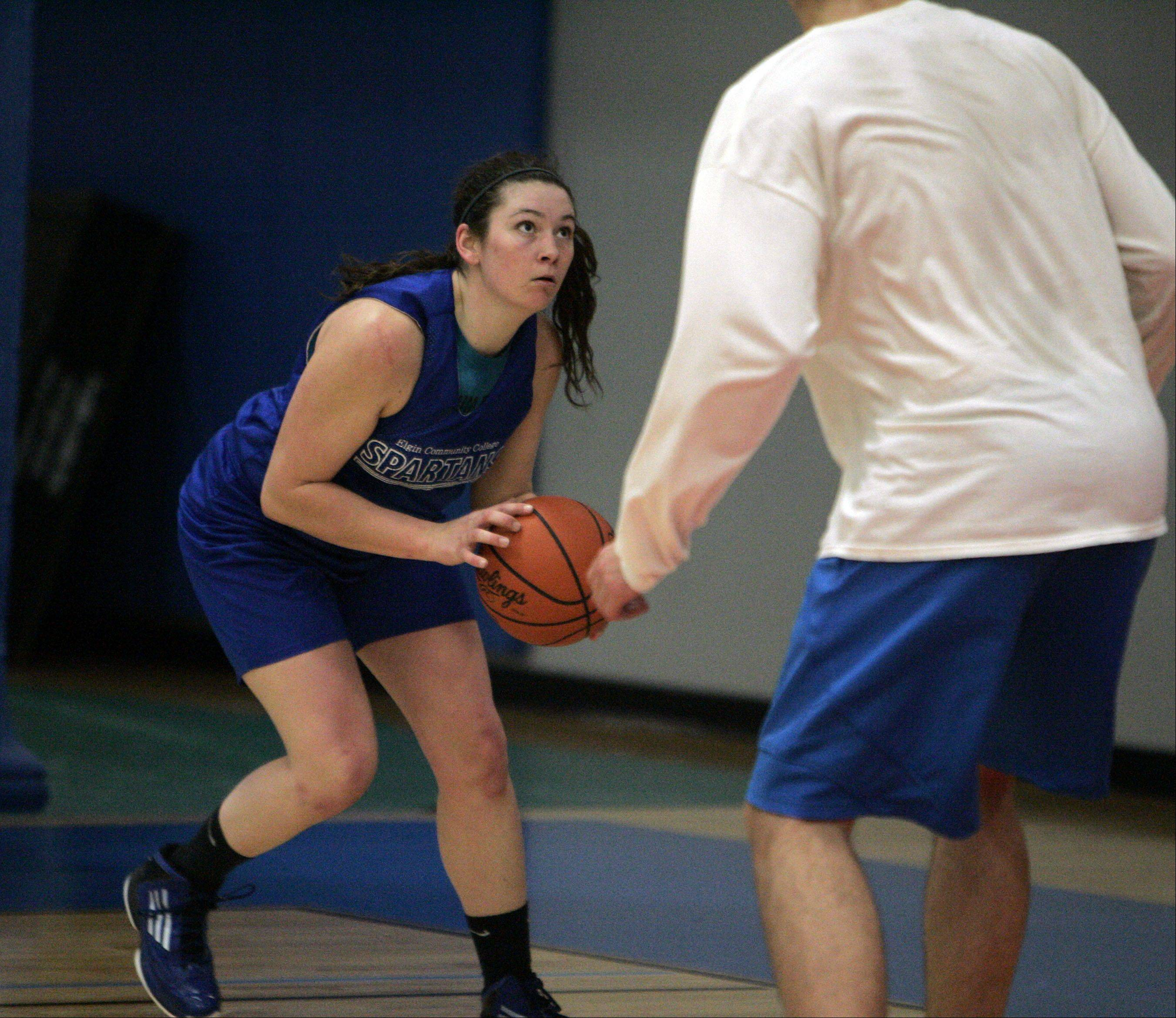 Alex Dumoulin of the Elgin Community College women's basketball team looks for an opening as the team practices for their upcoming bid in the national tournament in East Peoria.