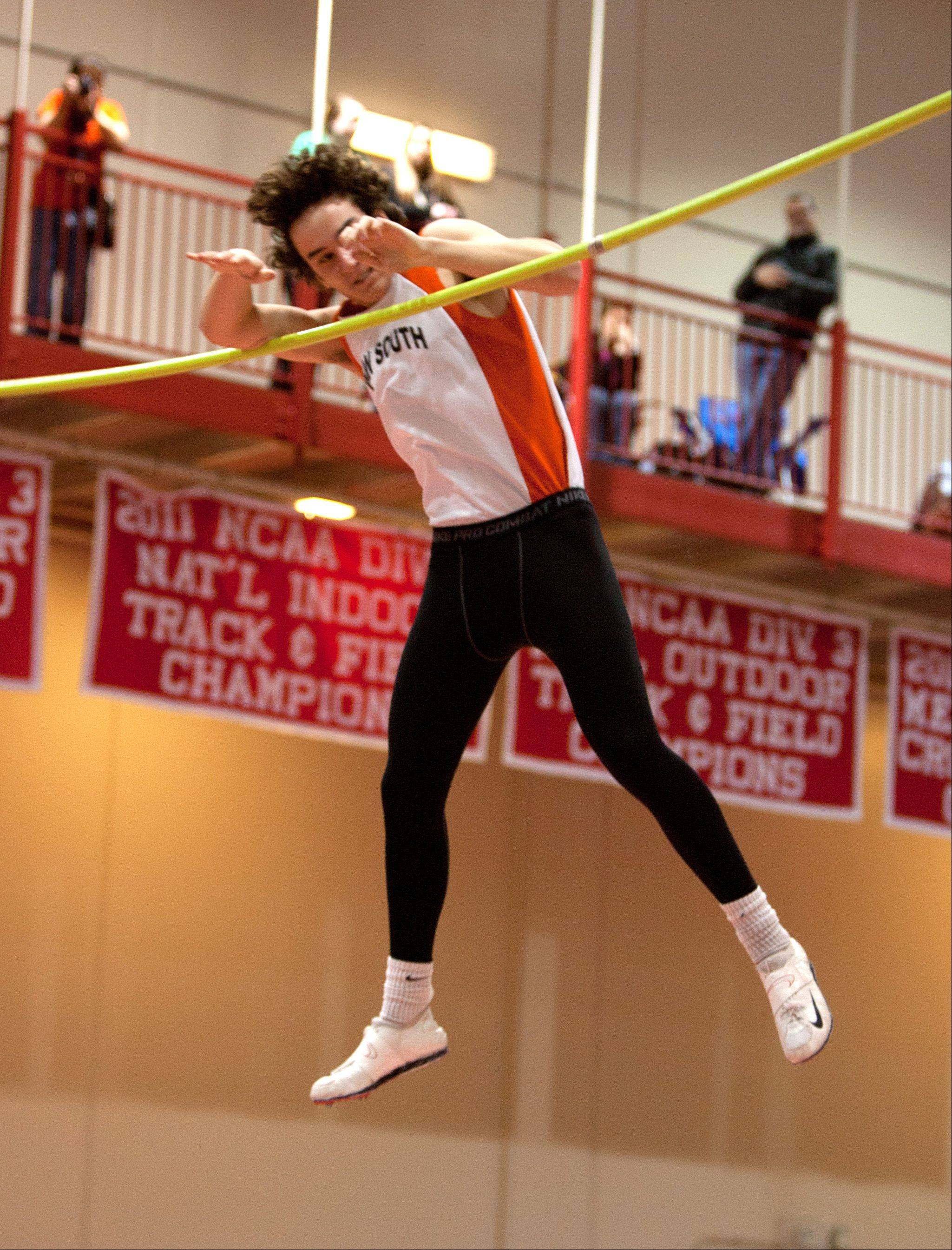 Wheaton Warrenville South's Mike Koehne knocks down the bar in the pole vault event, during the DuPage Valley Conference boys track meet.