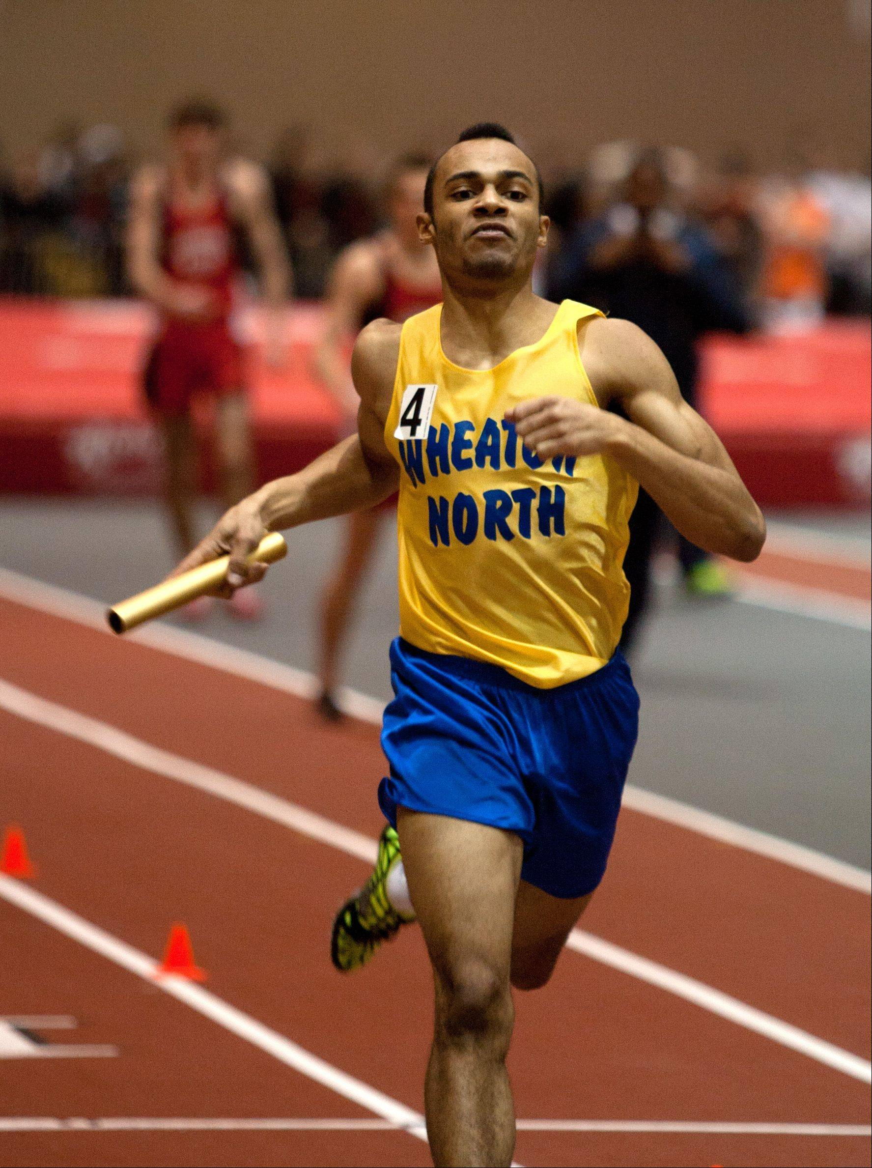 Wheaton North's Micaiah Steele anchors a 4 x400 meter win, during the DuPage Valley Conference boys track meet.