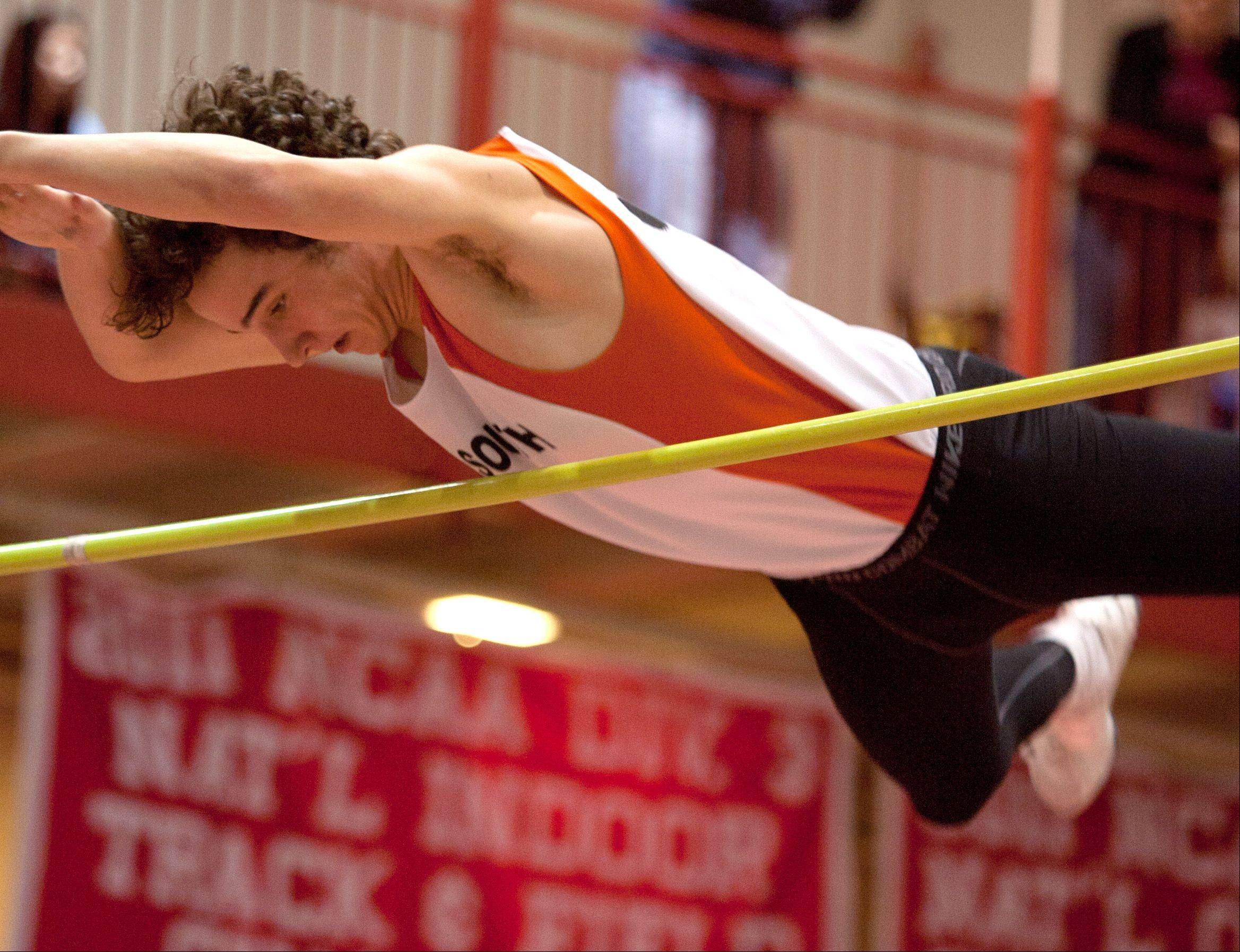 Wheaton Warrenville South's Mike Koehne knocks clears the bar in the pole vault event, during the DuPage Valley Conference boys track meet.