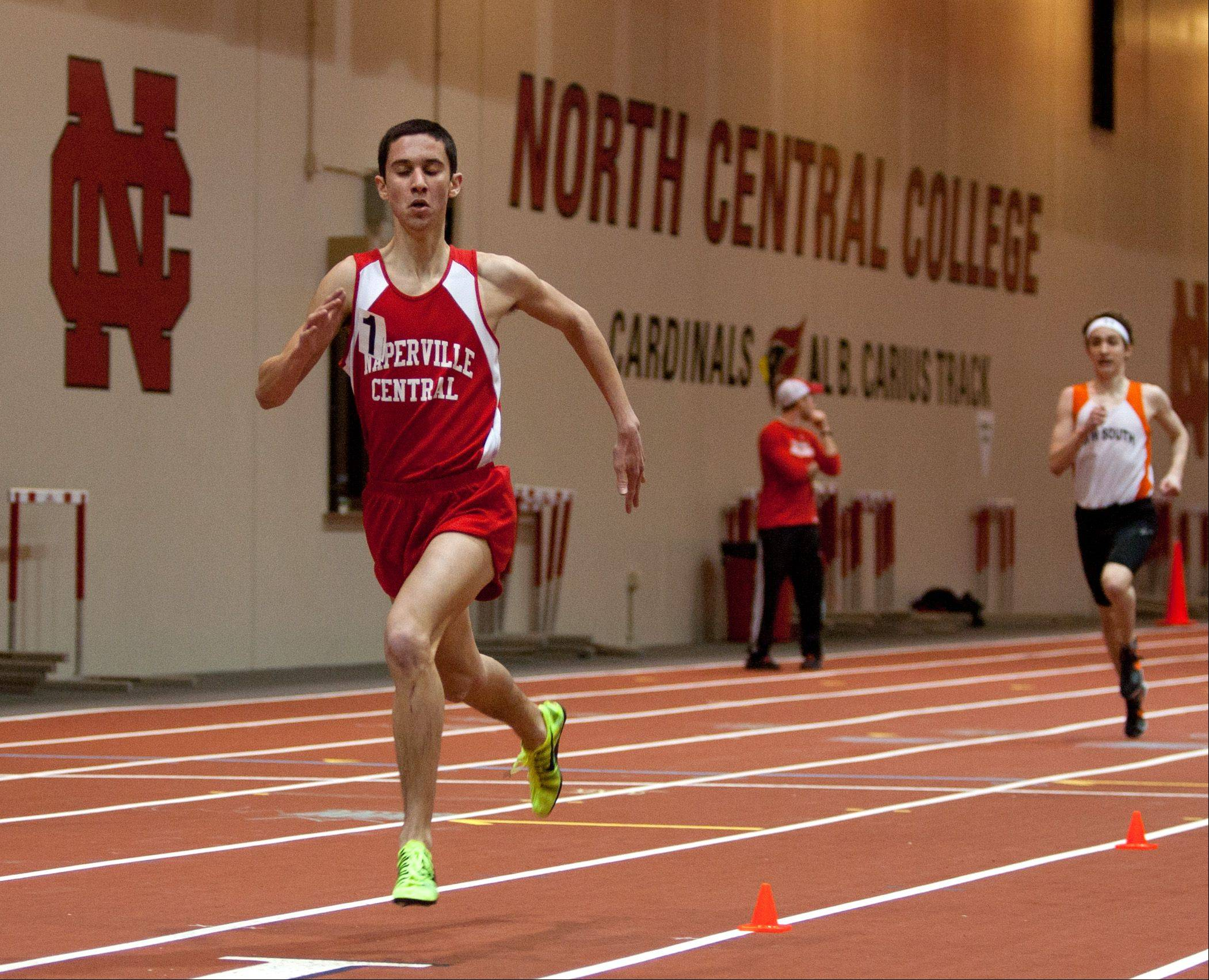Naperville Central's Ethan Brodeur wins the 1600 meter run, during the DuPage Valley Conference boys track meet.