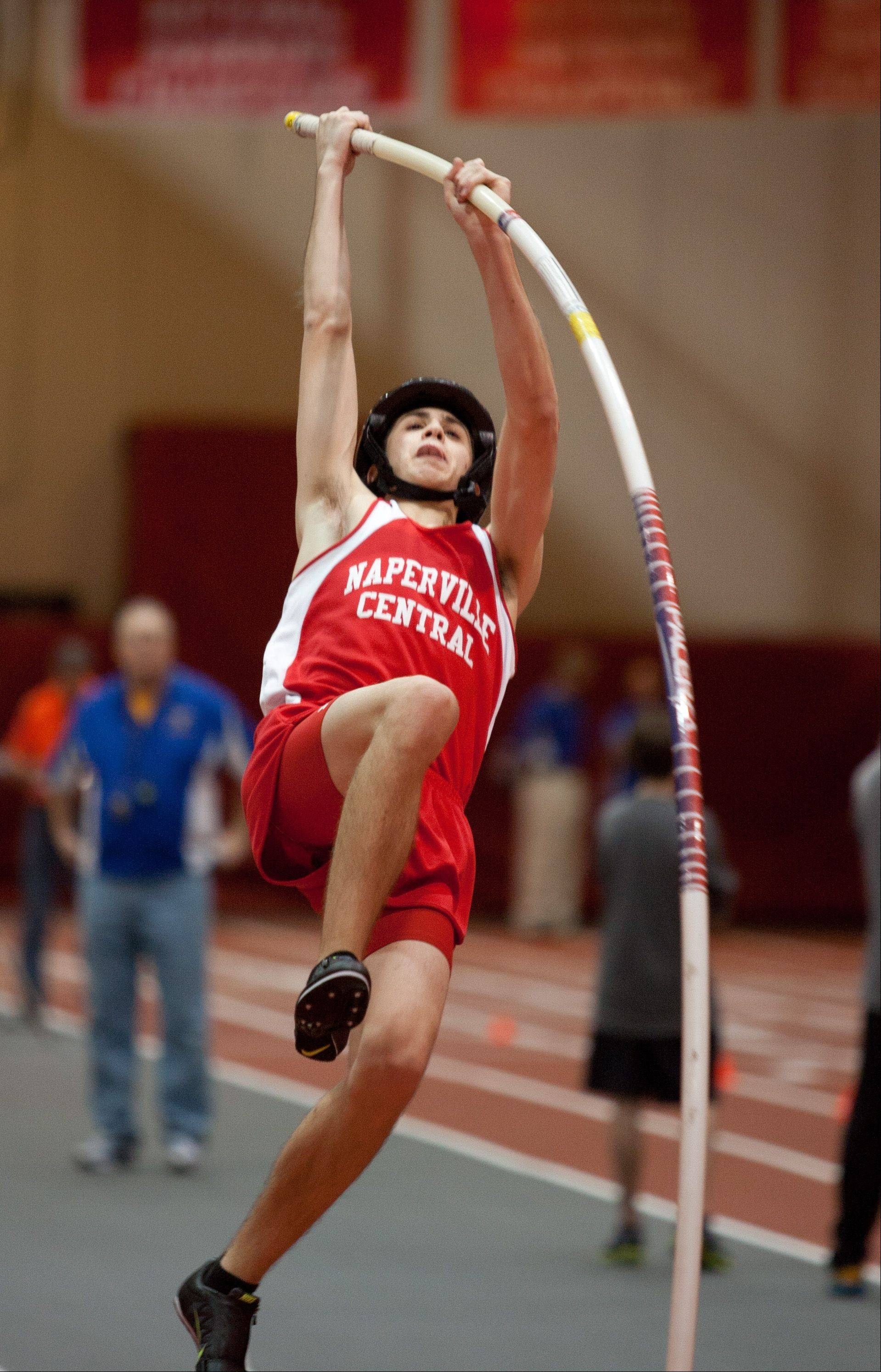 Naperville Central's Justin Allara competes in the pole vault event, during the DuPage Valley Conference boys track meet.