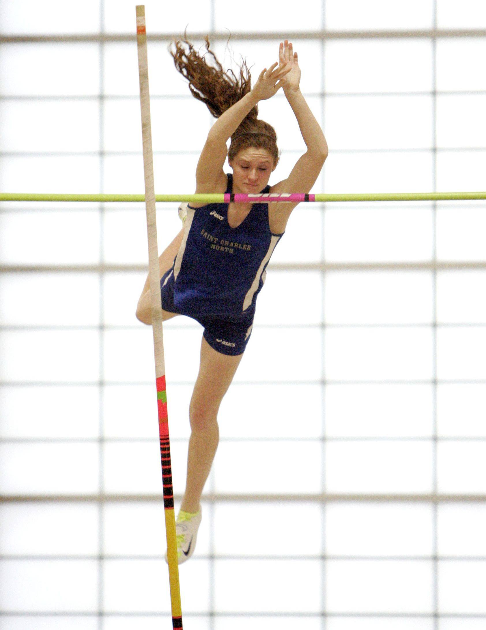 Jessica Grill of St. Charles North in the pole vault during the Upstate Eight Conference indoor track meet at Batavia High School Friday.