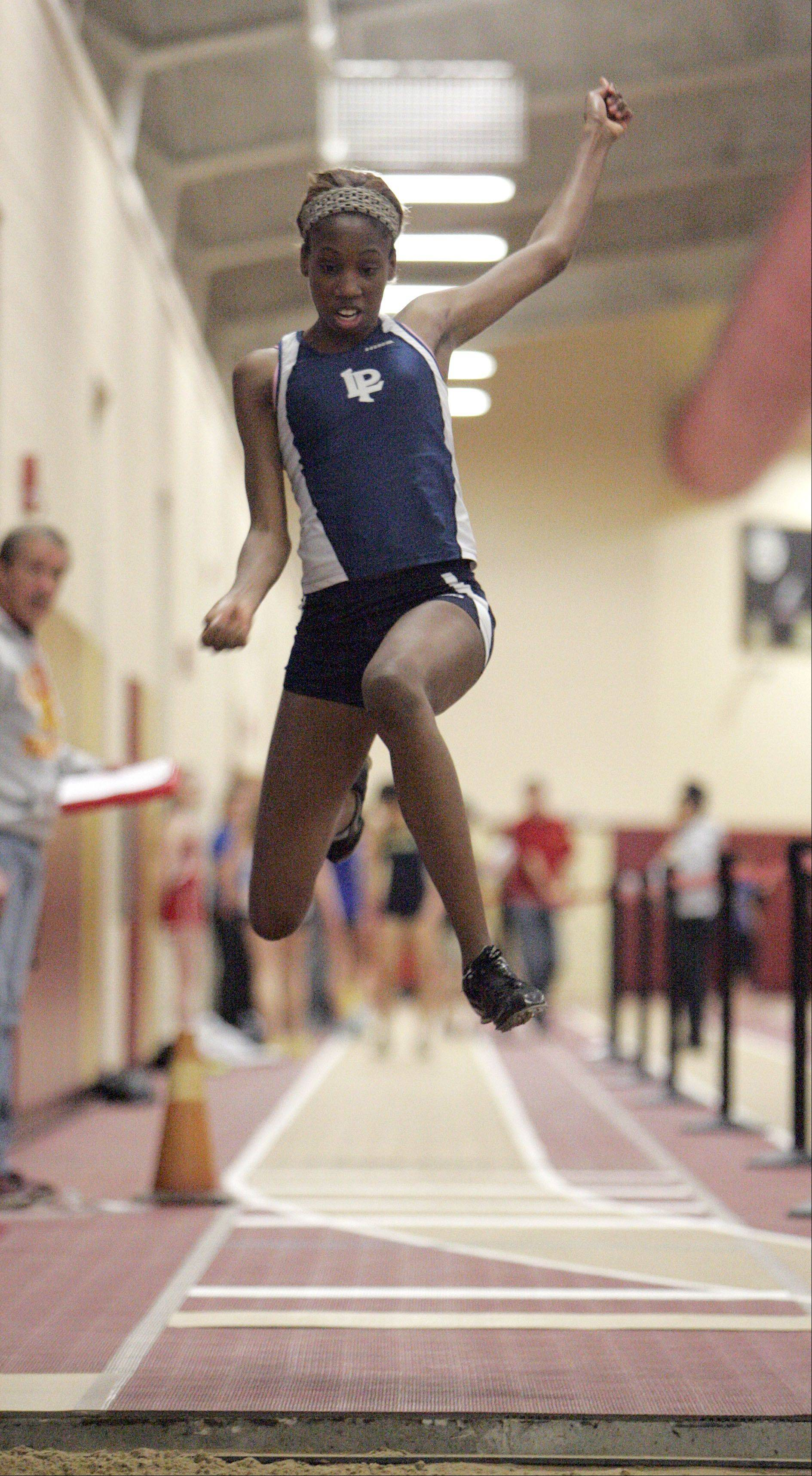 Tyshai Freeman of Lake Park in the triple jump during the Upstate Eight Conference indoor track meet at Batavia High School Friday.