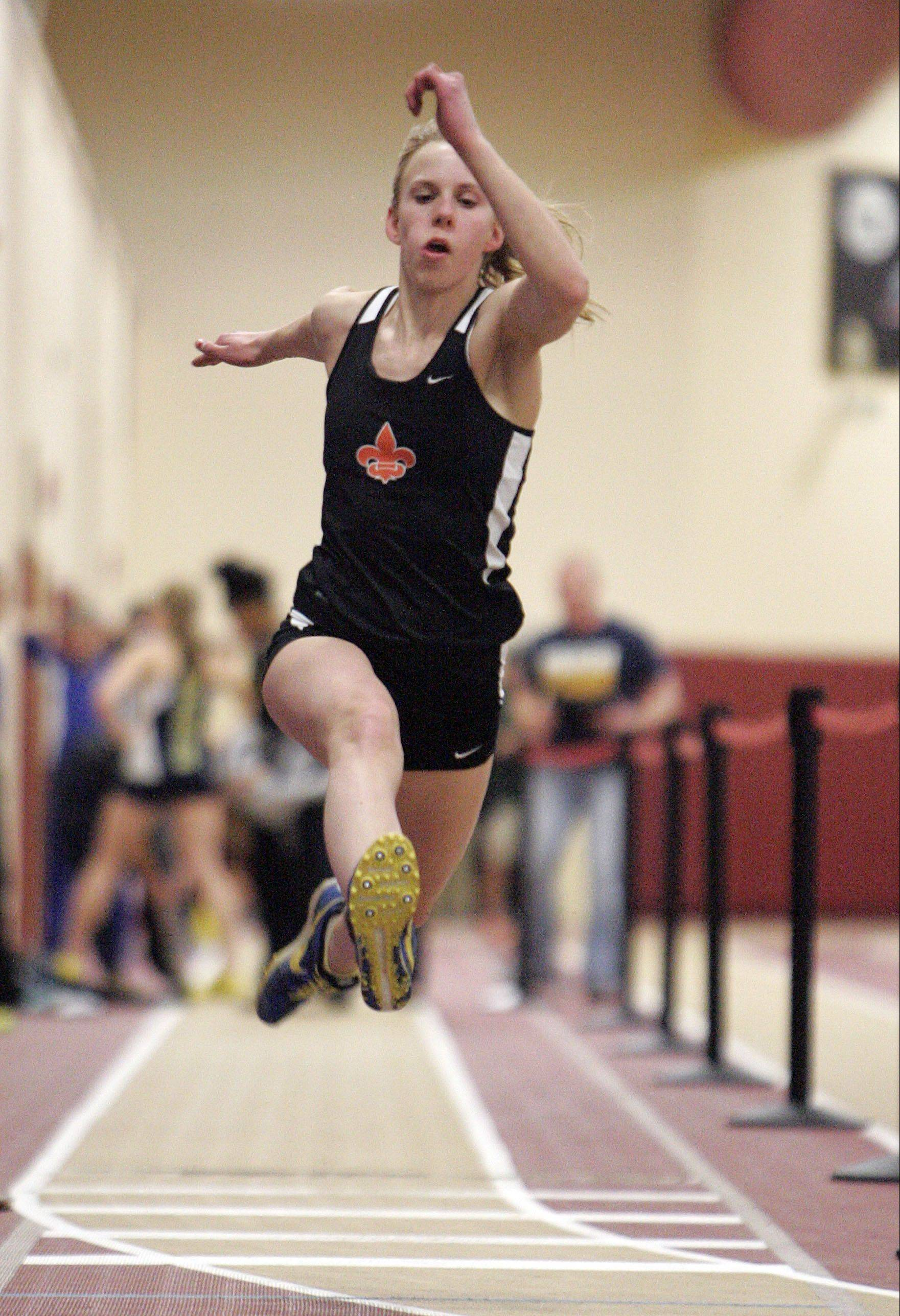 Above: Allison Chmelik competes in the triple jump for runner-up St. Charles East Friday at the UEC indoor meet at Batavia. Below from left to right: St. Charles North's Jessica Grill, Geneva's McKenna Happold and Batavia's Leah Narup.
