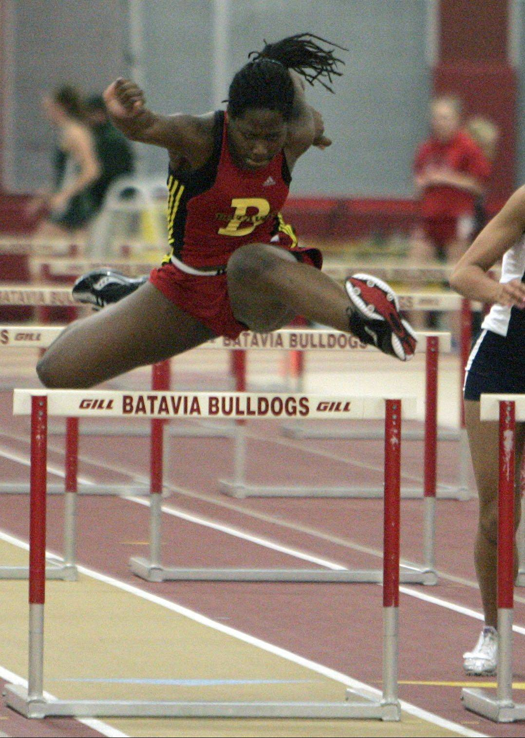 Leah Narup of Batavia, left, in the 55 meter hurdles during the Upstate Eight Conference indoor track meet at Batavia High School Friday. Chelsey White, of Lake Park is also pictured.