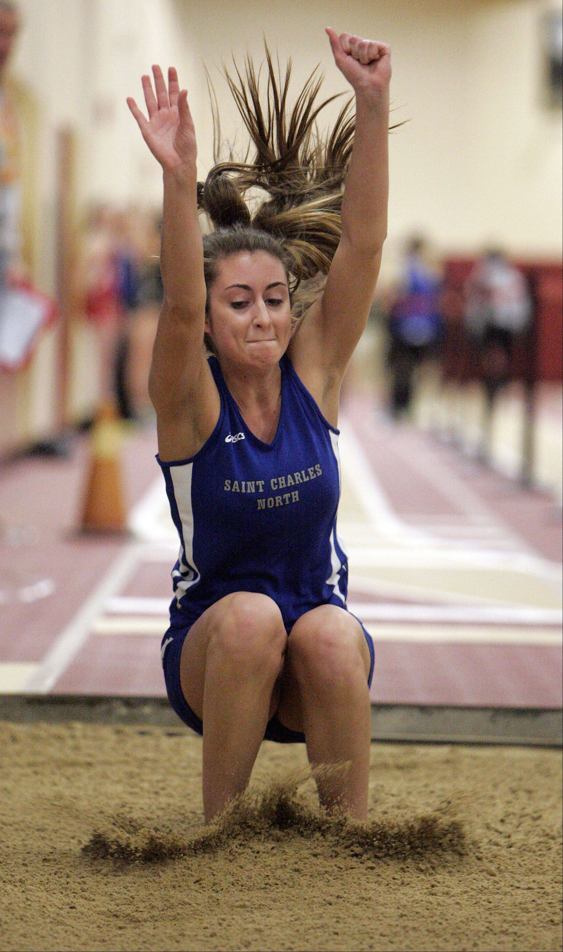 Kaylee Raucci of St. Charles North in the triple jump during the Upstate Eight Conference indoor track meet at Batavia High School Friday.
