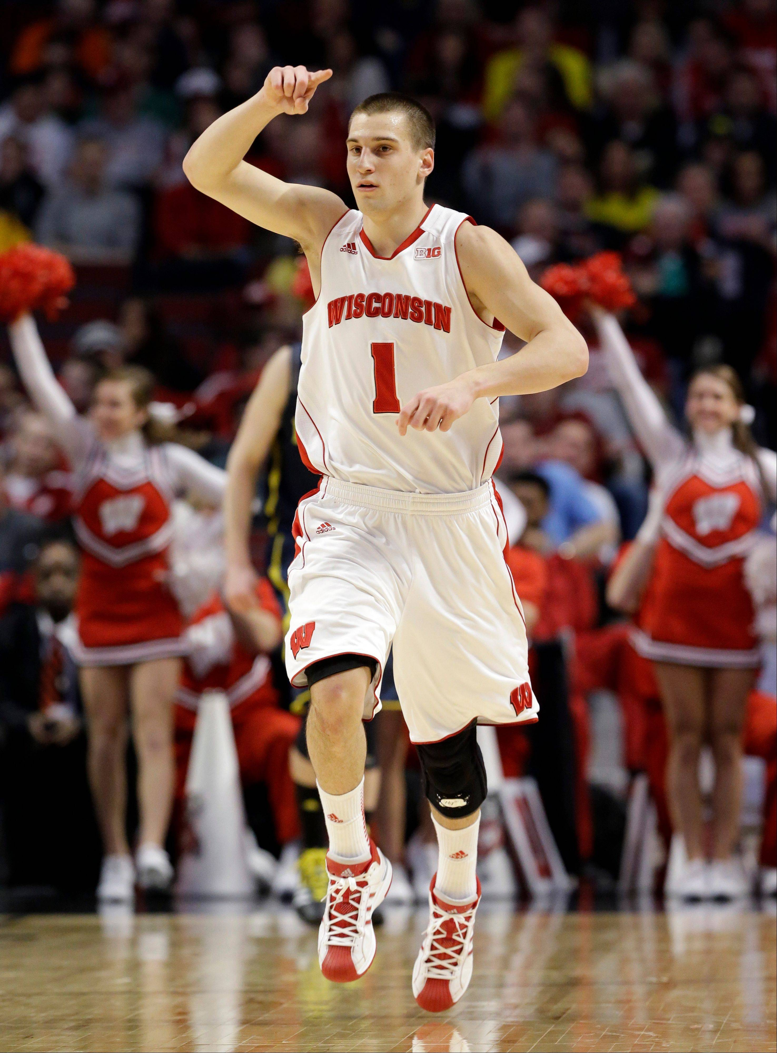 Wisconsin's Ben Brust reacts after scoring during the second half of an NCAA college basketball game at the Big Ten tournament against MichiganFriday, March 15, 2013, in Chicago.