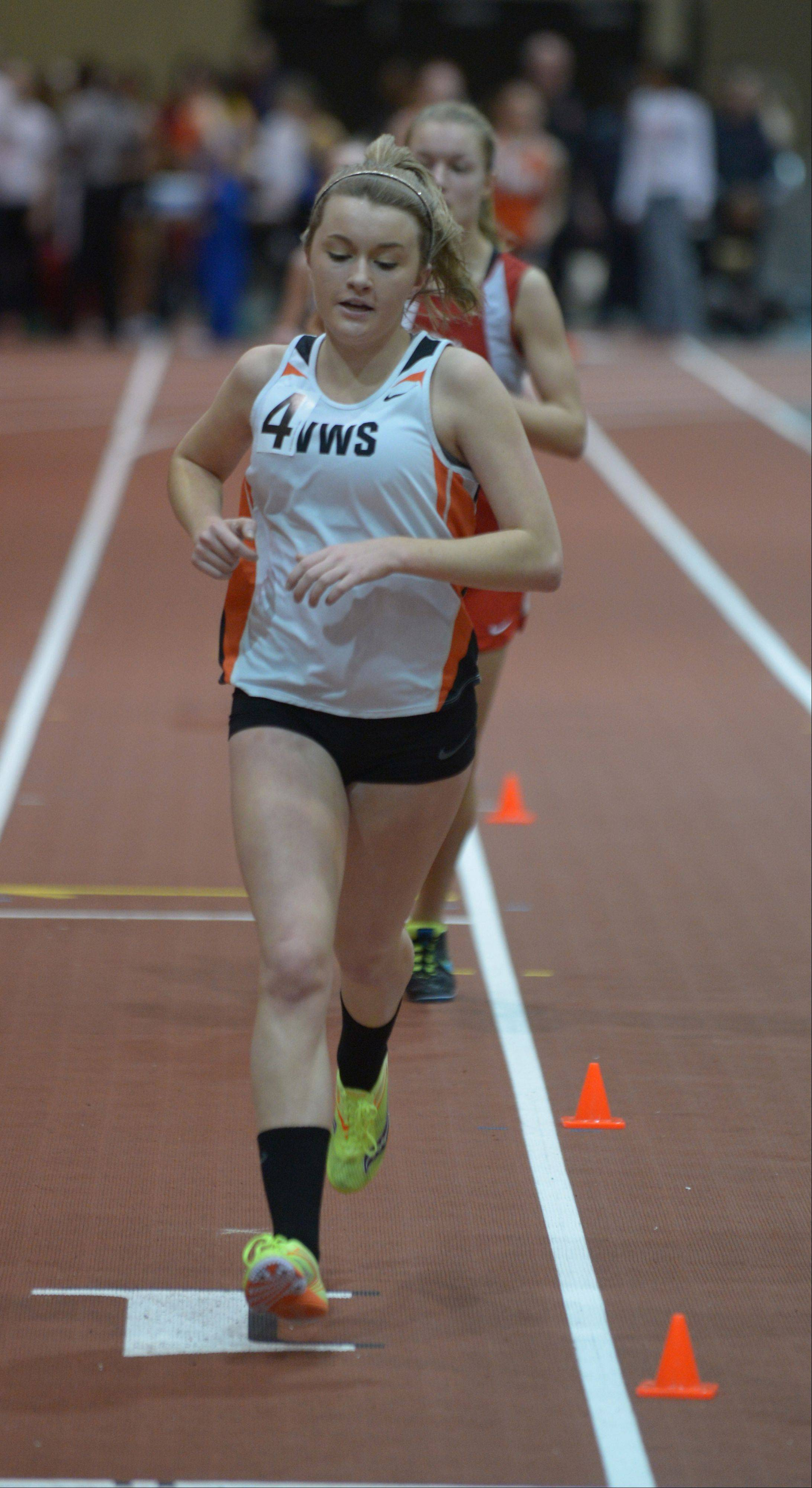 Kayla Kightlinger of Wheaton Warrenville South runs the 3200 during the DuPage Valley Conference girls indoor track meet at North Central College Thursday.