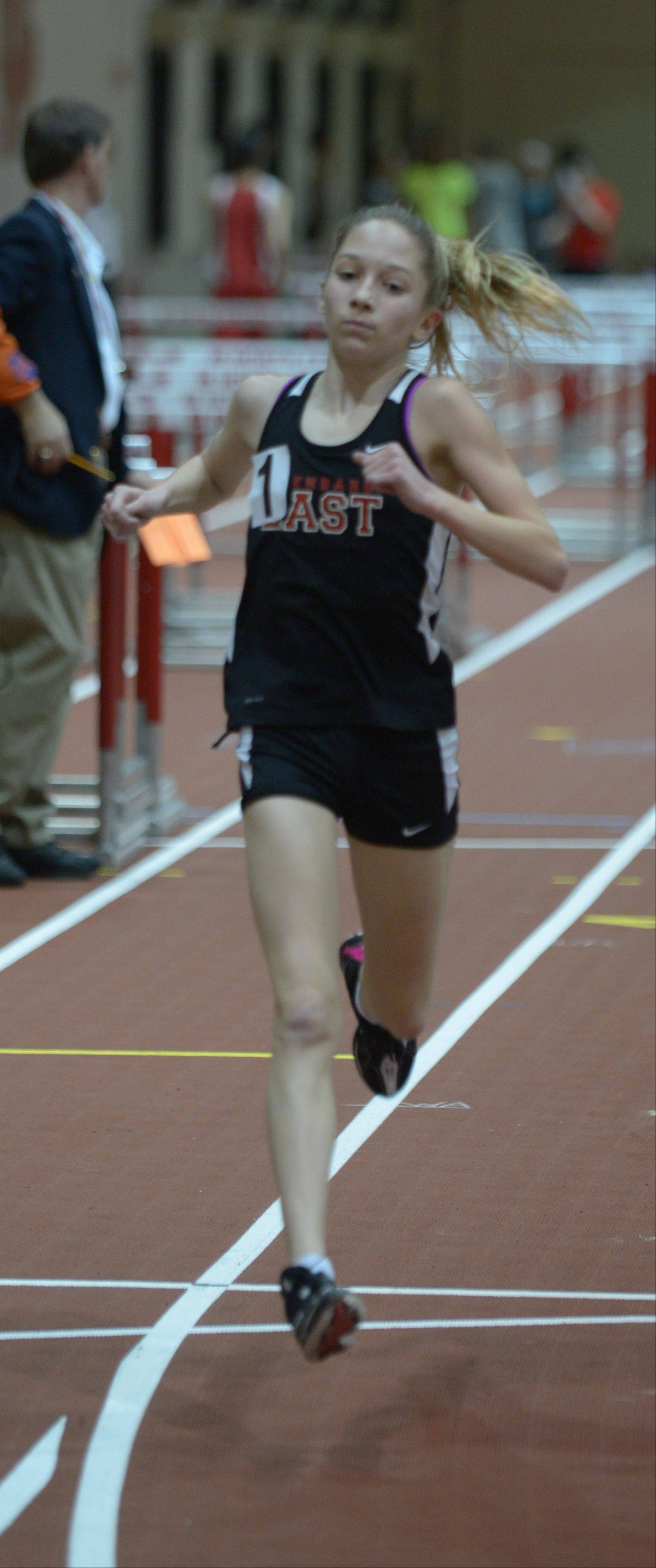 Lindsey Graham of Glenbard East runs the 3200 during the DuPage Valley Conference girls indoor track meet at North Central College Thursday.