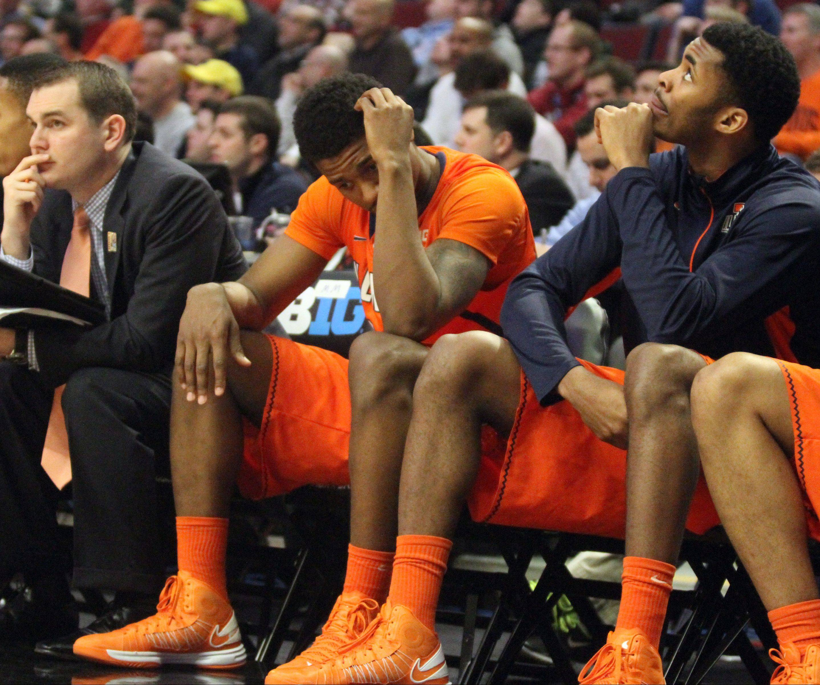 Illinois players react Friday during the final seconds of their loss to Indiana in the Big Ten men's basketball tournament at the United Center.