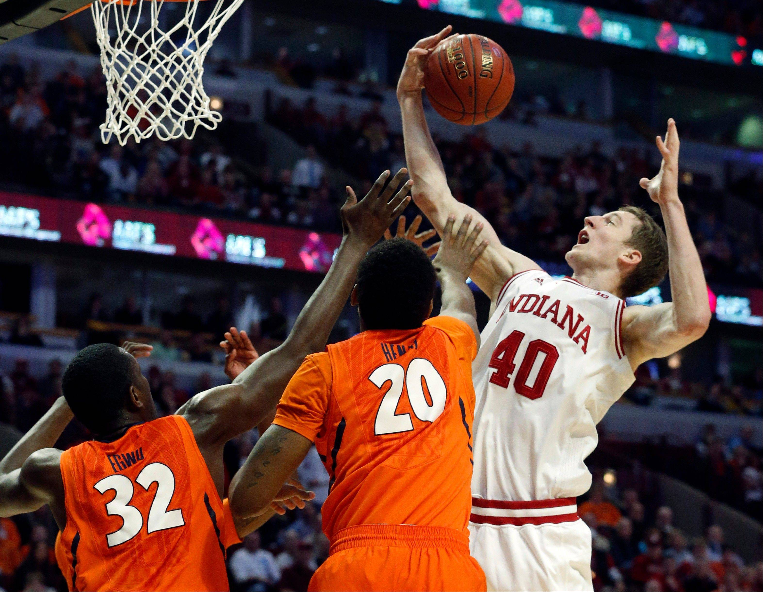 Indiana's Cody Zeller rebounds over Illinois' Nnanna Egwu (32) and Myke Henry (20) during the first half of an NCAA college basketball game at the Big Ten tournament Friday, March 15, 2013, in Chicago. (AP Photo/Charles Rex Arbogast)