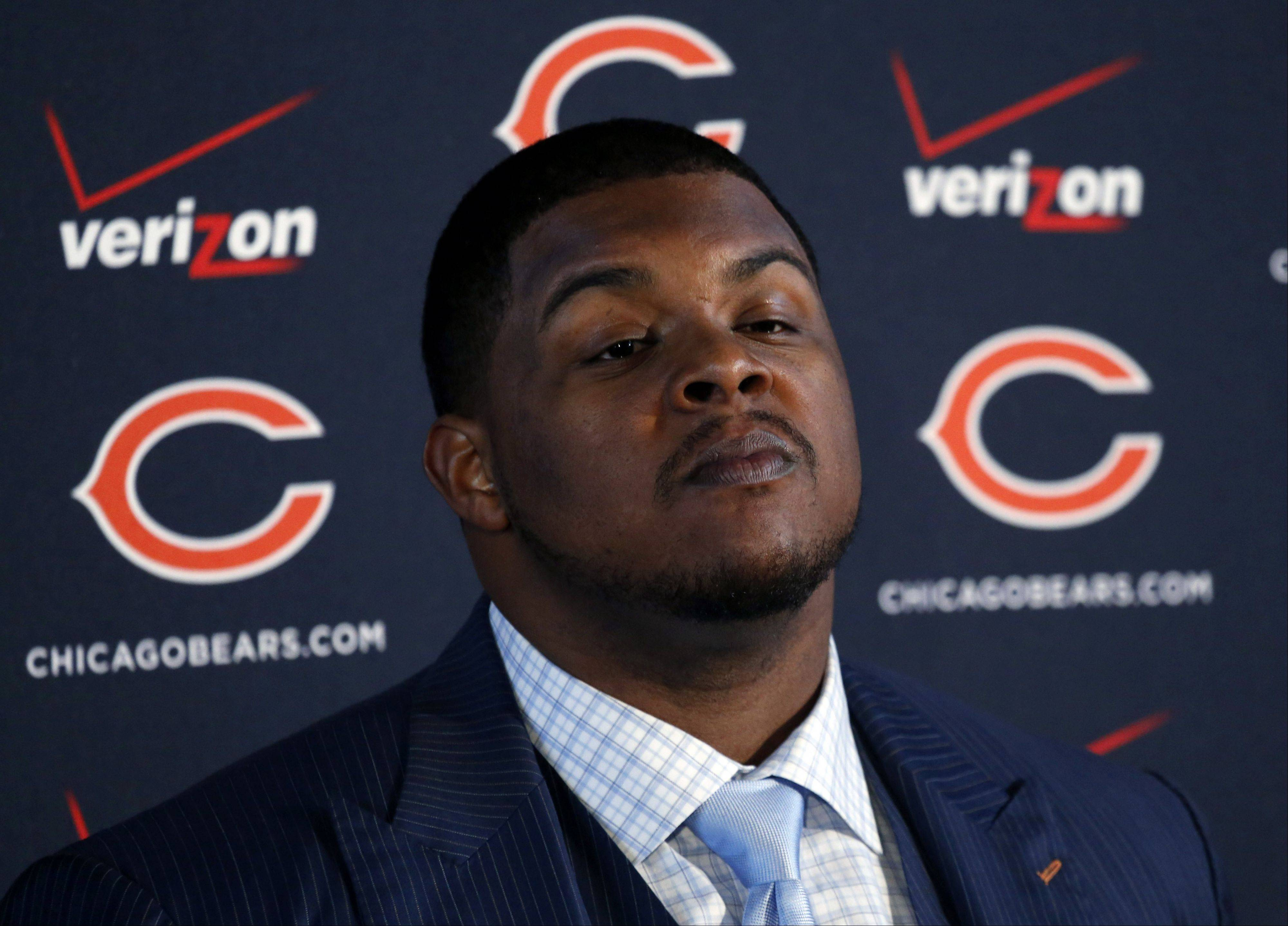 Left tackle Jermon Bushrod listens to a question after Chicago Bears general manager Phil Emery announced the signing of Bushrod during an NFL football news conference, Wednesday, March 13, 2013, in Lake Forest, Ill. The Bears addressed a huge hole on the offensive line by agreeing to a five-year contract Bushrod and filled another need by signing versatile tight end Martellus Bennett on Tuesday.