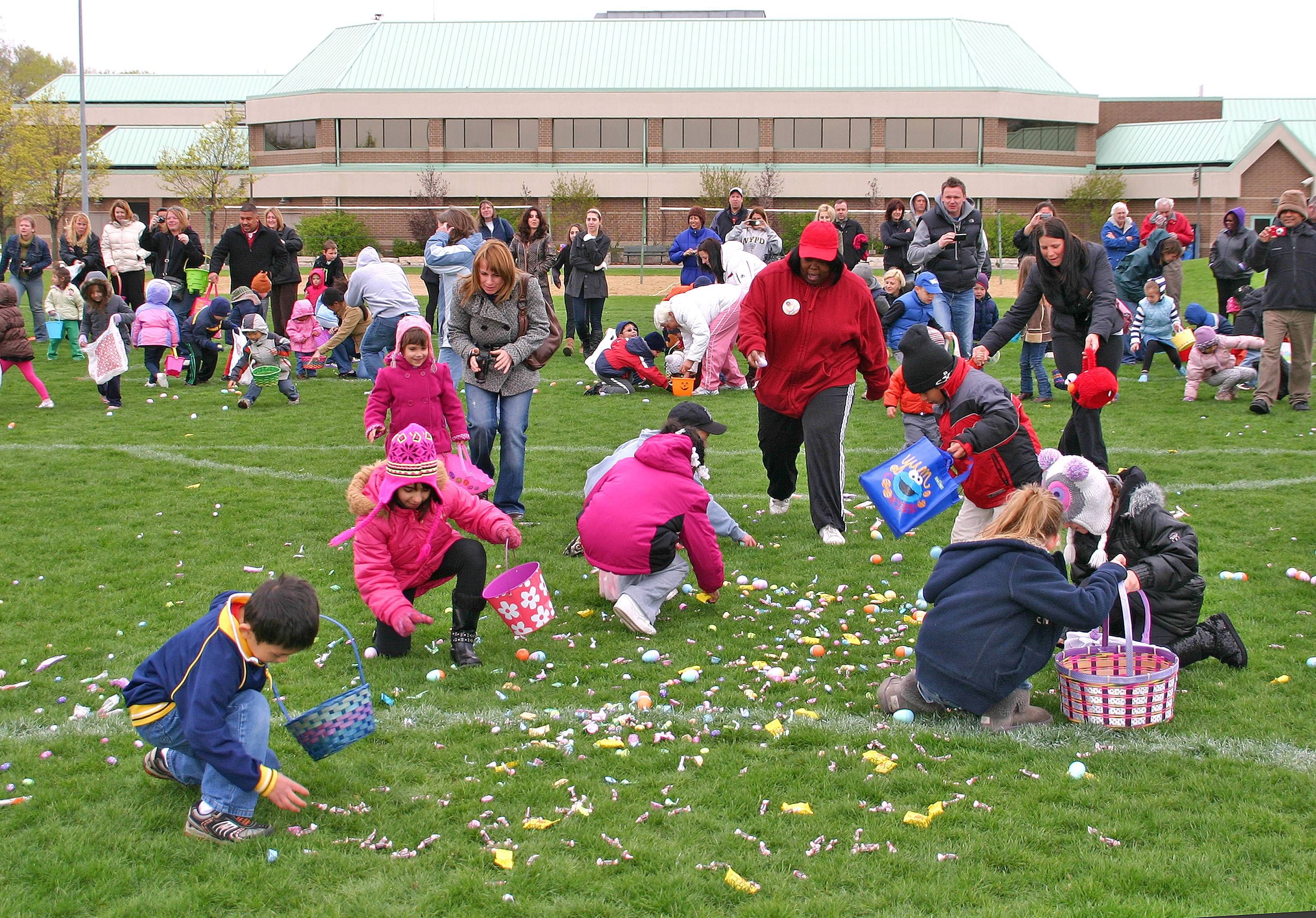 Kids of all ages hop through Prairie Lakes Park filling their baskets with goodies at the annual Free Easter Egg Hunts sponsored by the Des Plaines Park District.