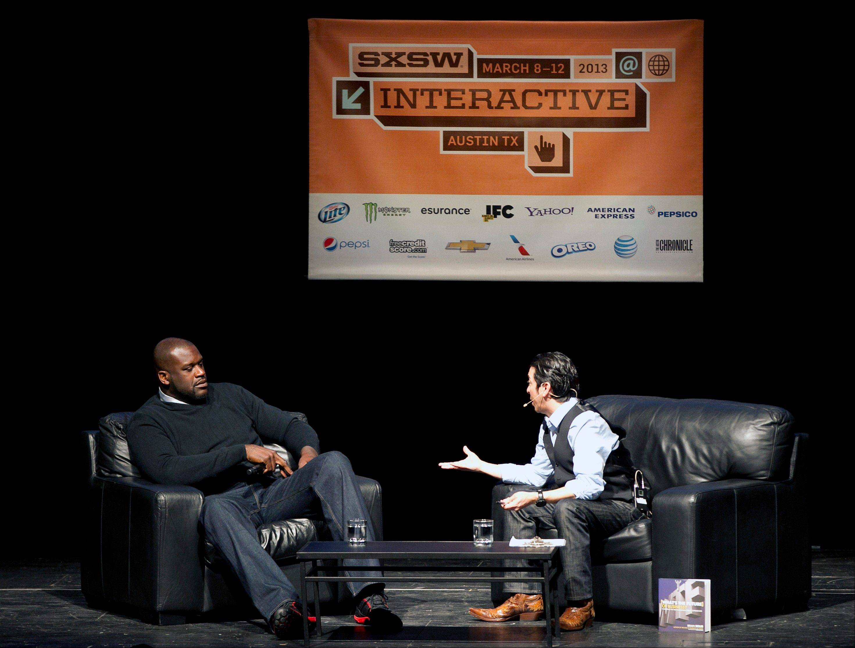 Former NBA basketball great Shaquille O�Neal talks Monday with Brian Solis at the South By Southwest Interactive Festival in Austin, Texas.