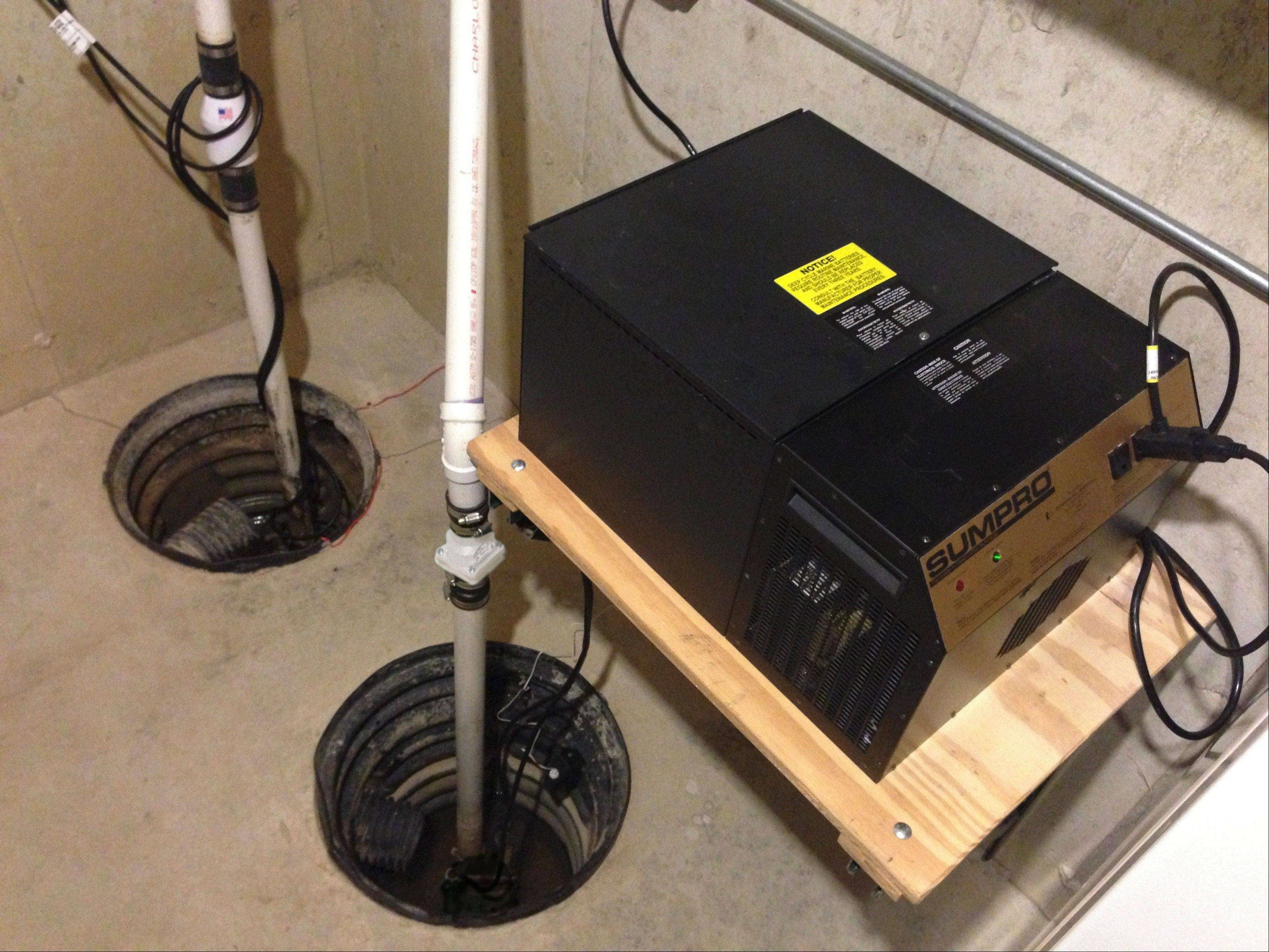 This sump pump setup, which includes the battery backup power source on the right, utilizes pumps by Metropolitan Industries of Romeoville.