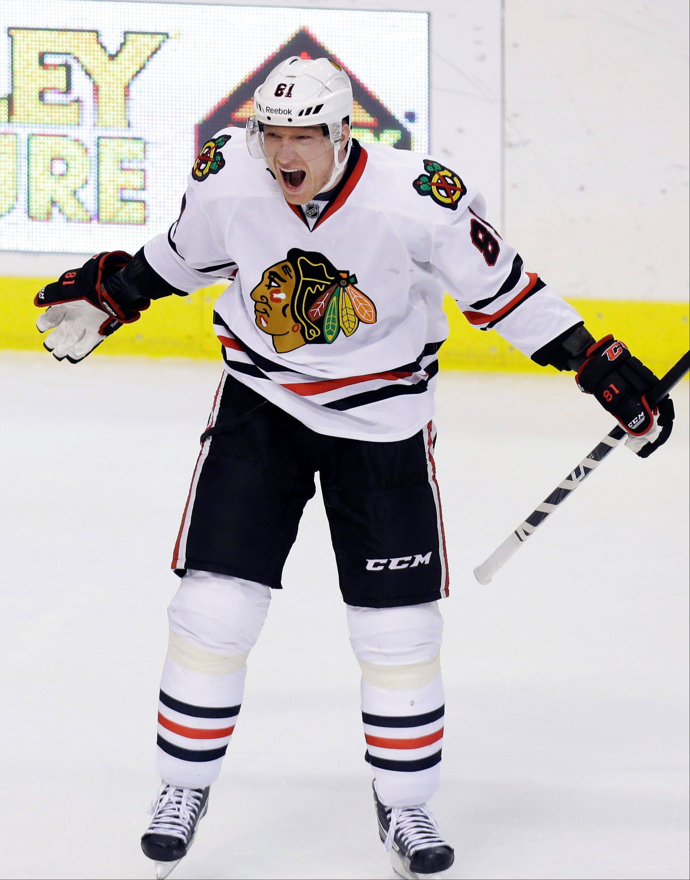 Chicago Blackhawks right wing Marian Hossa (81) of Slovakia celebrates scoring a goal during the Hawks� win against the Stars Saturday night in Dallas.